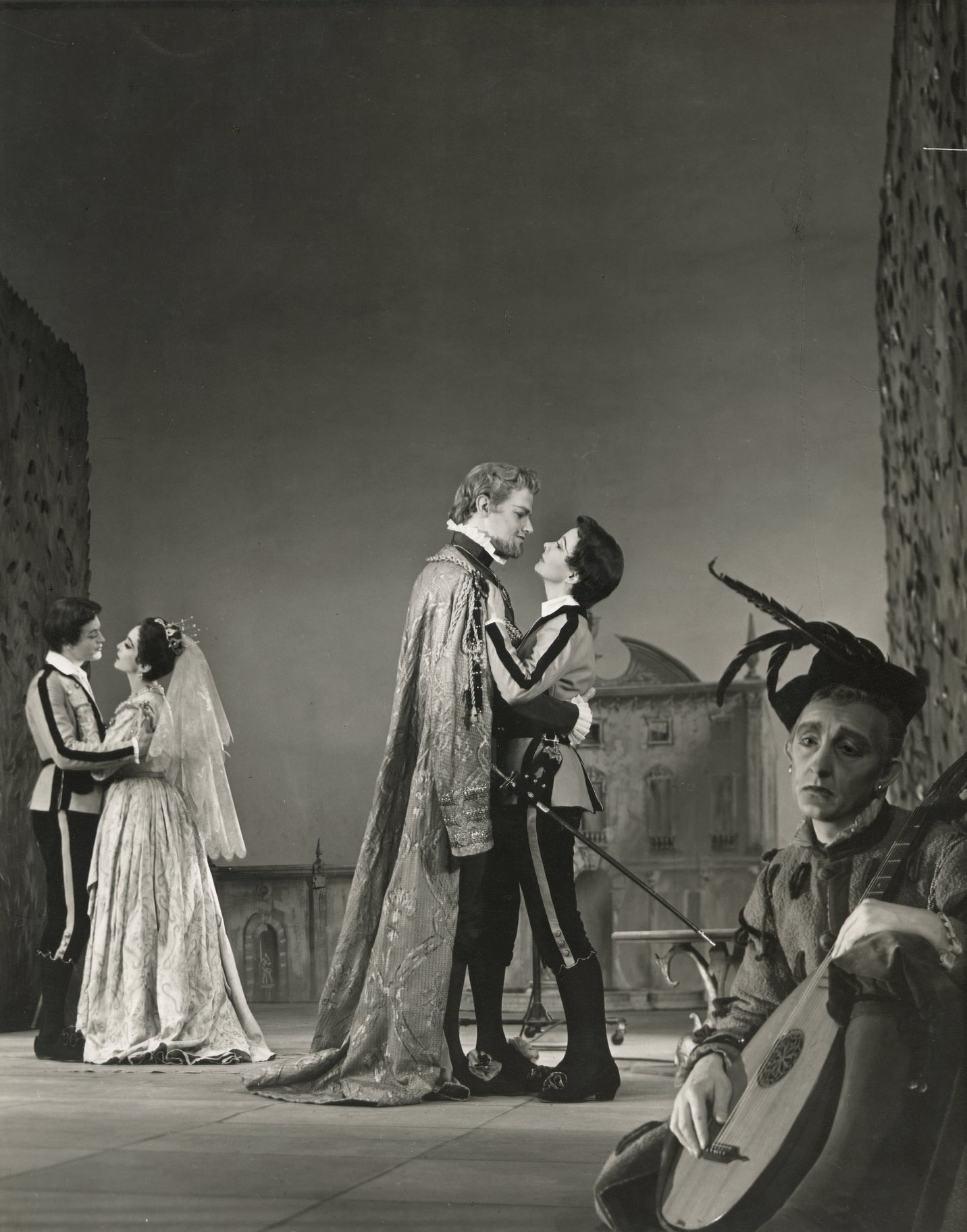 Viola stands with Orsino and Sebastian stands with Olivia both in loving embraces while Feste sits and looks sad in the 1955 production of Twelfth Night.