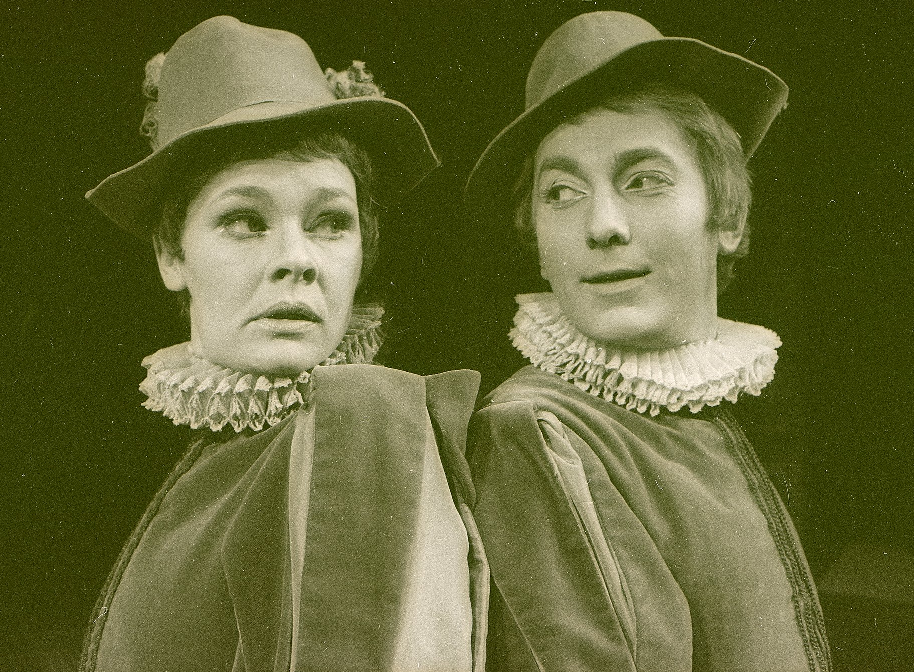Viola and Sebastian stand back to back wearing identical hats and ruffs in the 1969 production of Twelfth Night.