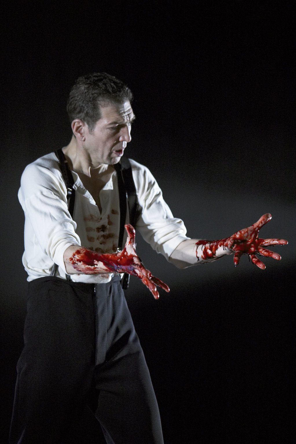 Macbeth with hands covered in blood.