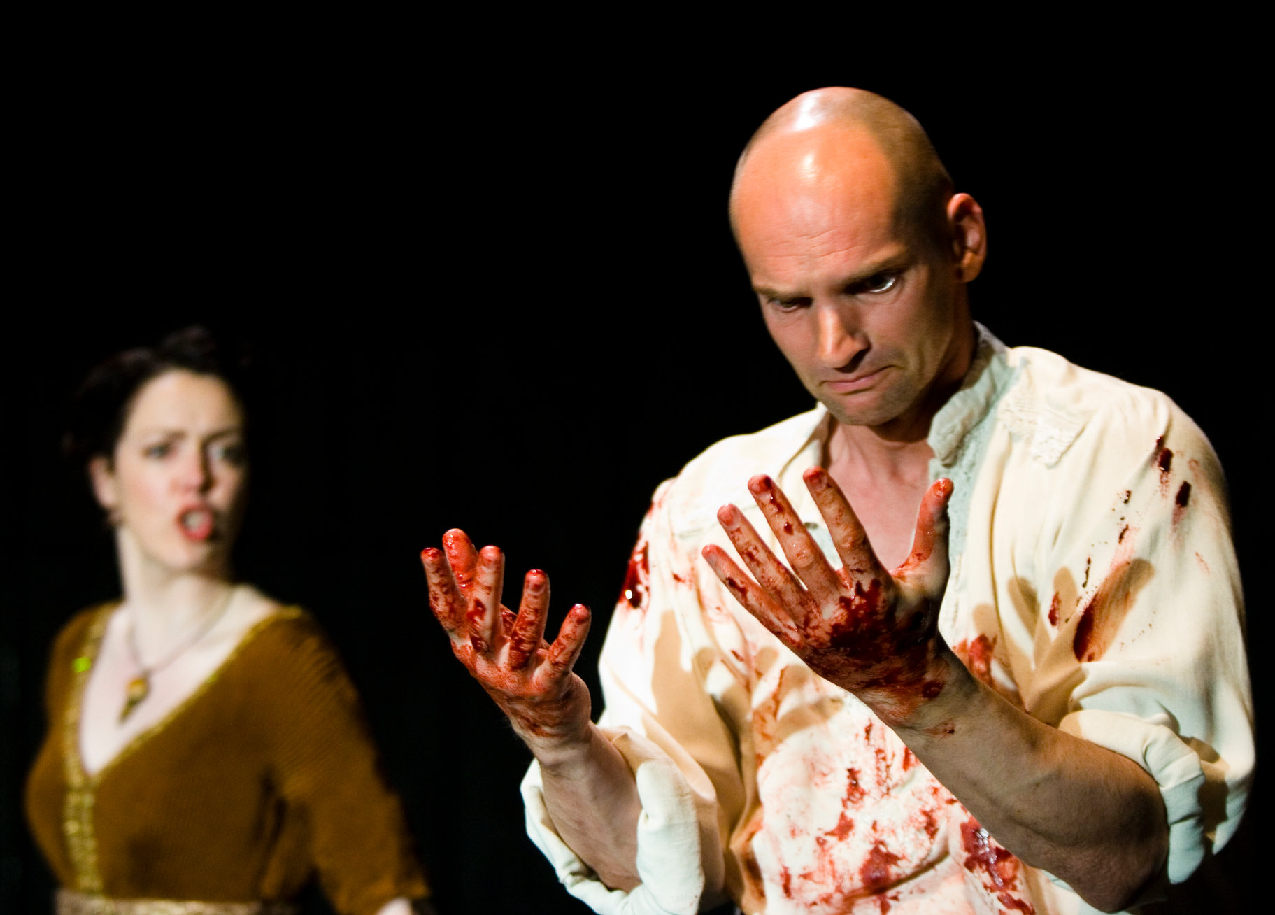 Macbeth looks at his bloody hands.
