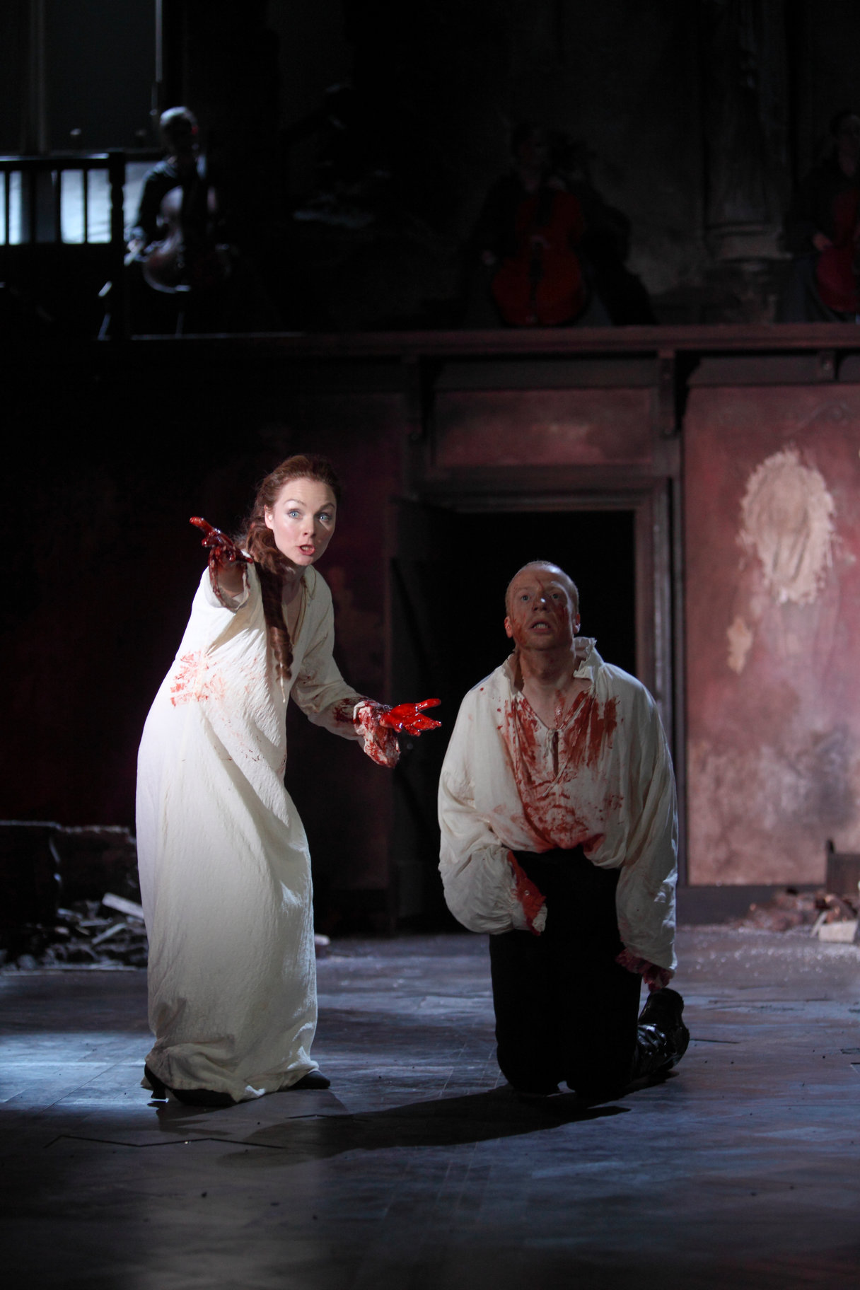 Lady Macbeth and her husband covered in blood from Duncan's murder.