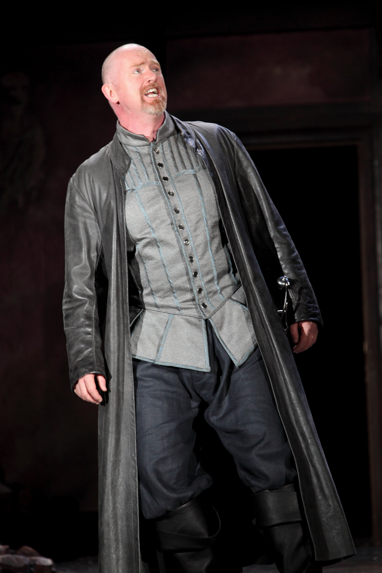 Macduff in long black leather coat