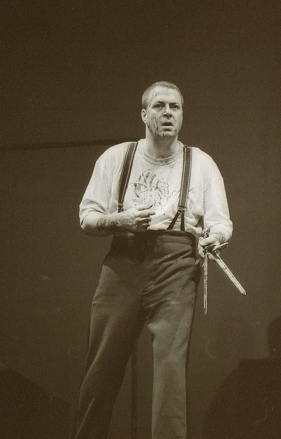 Macbeth with bloodied daggers after Duncan's murder.