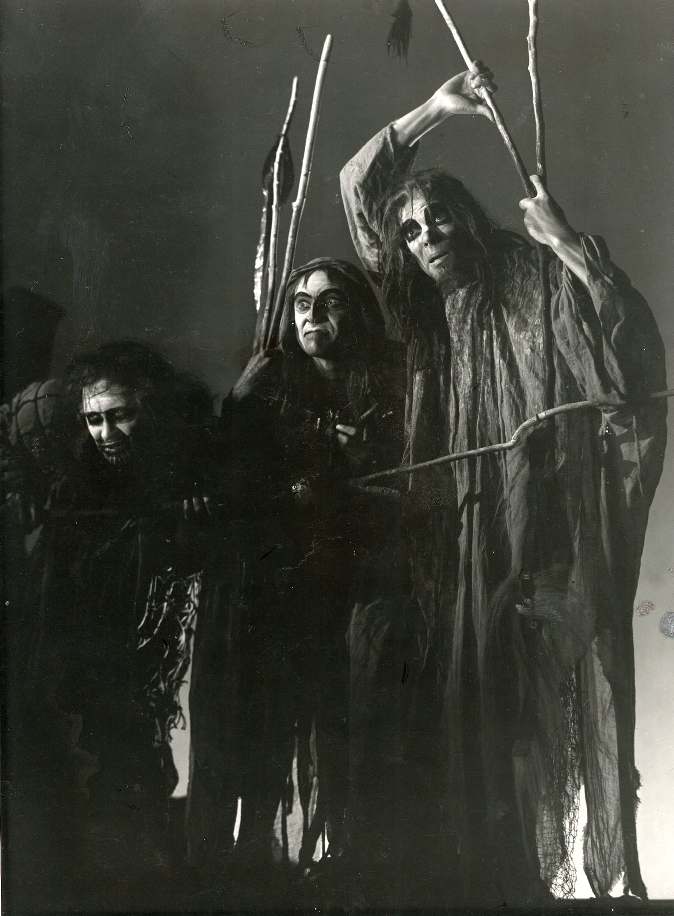 The three witches with long hair, rags and sticks.
