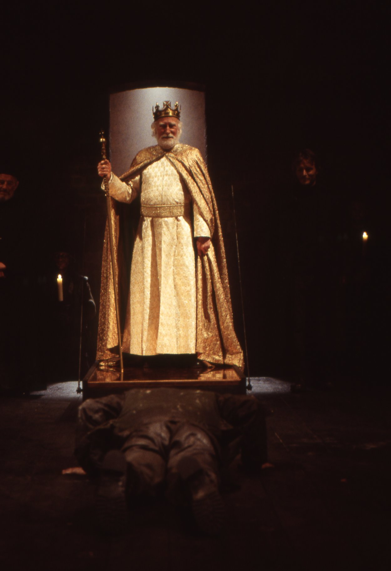 Macbeth lies at the feet of King Duncan.