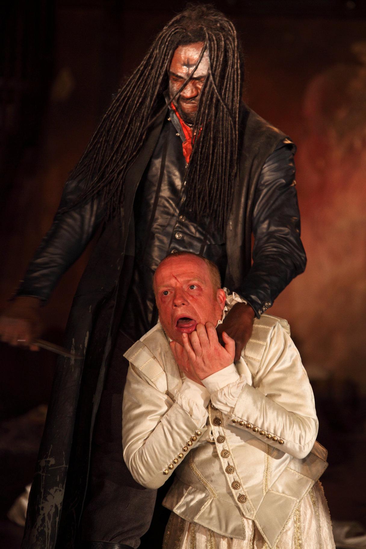 Banquo's ghost menaces Macbeth.