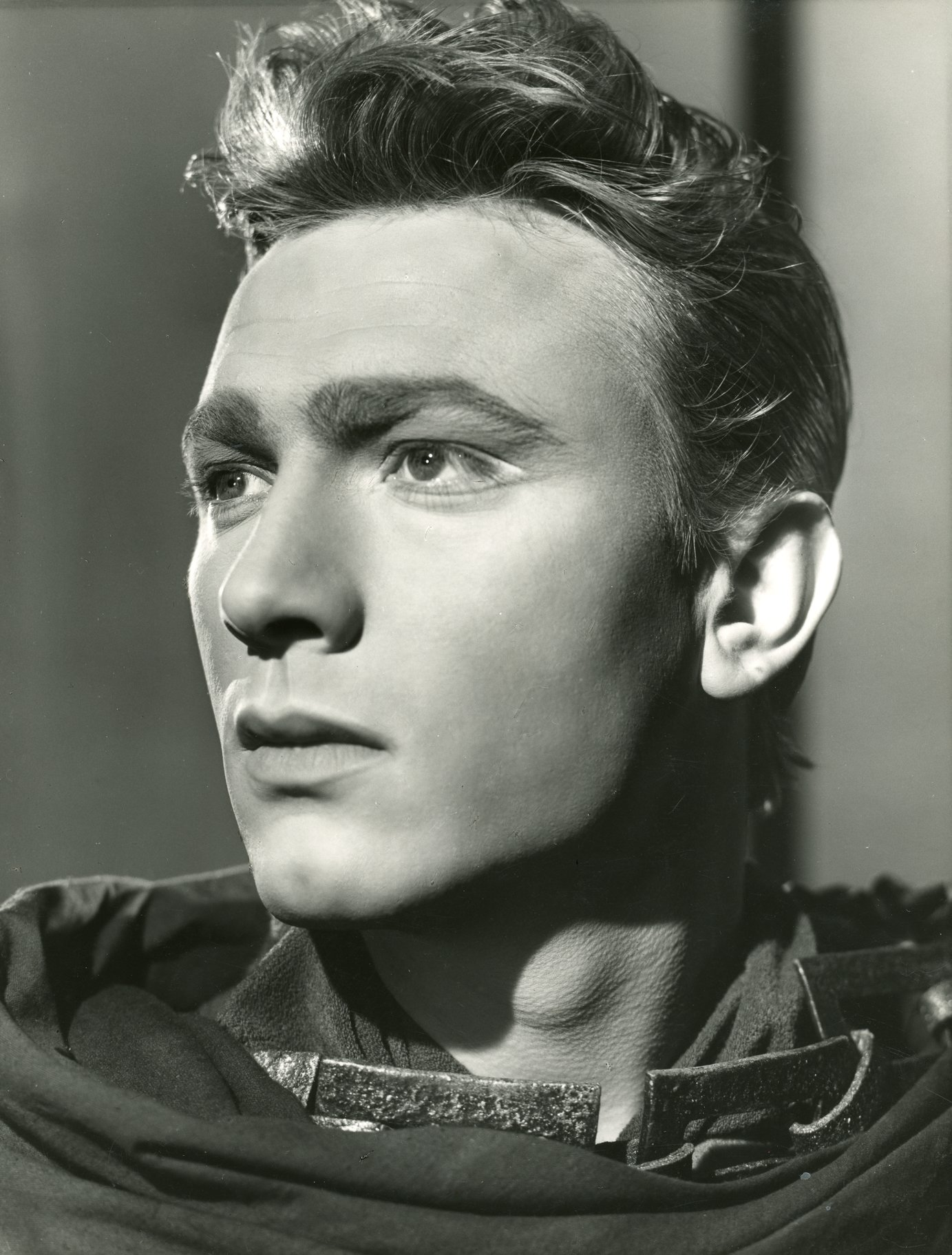Laurence Harvey as Malcolm.