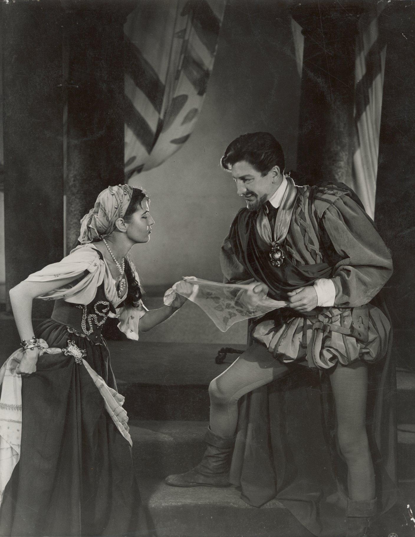 Bianca gives Cassio Desdemona's handkerchief.
