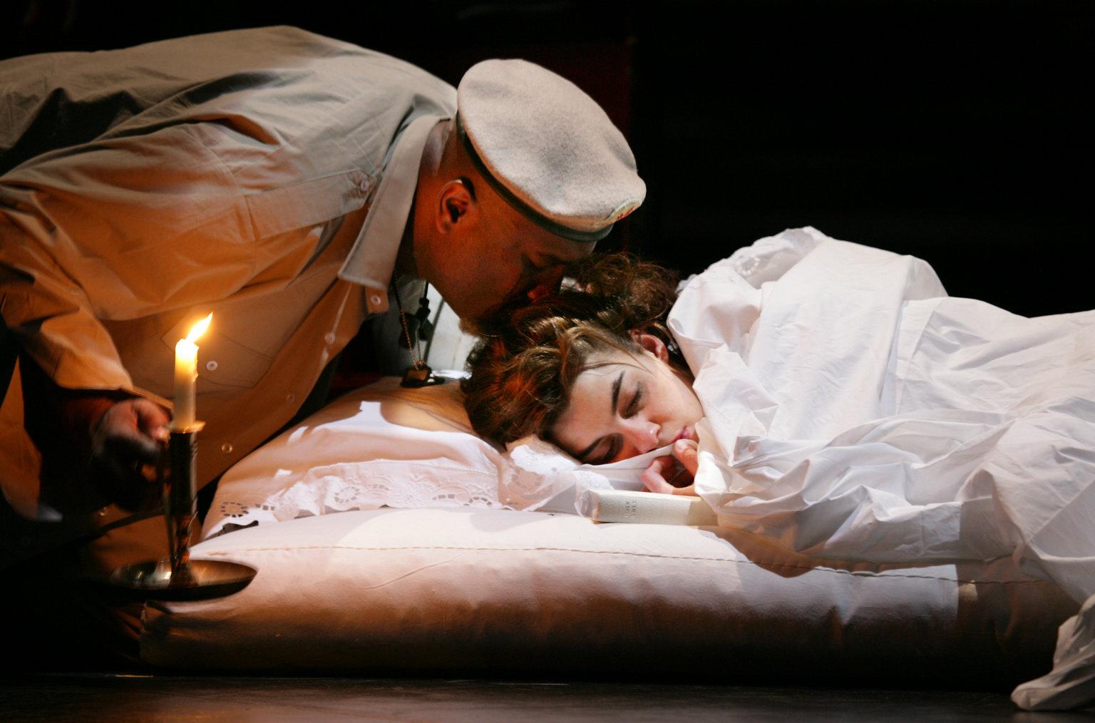 Othello prepares to kill Desdemona.