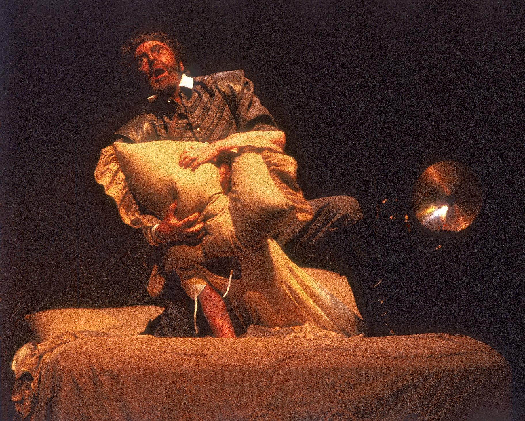 Othello suffocates Desdemona.