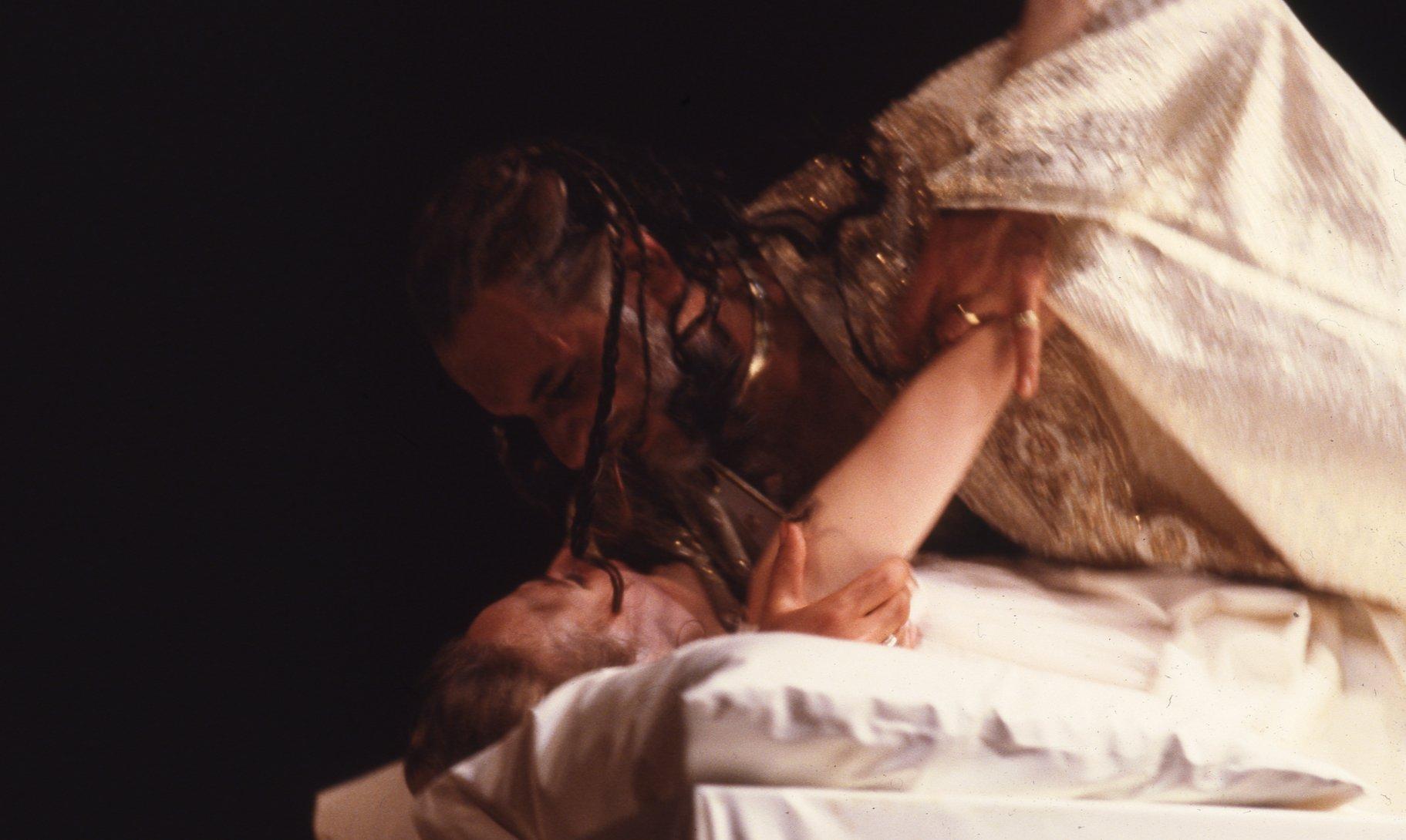 Othello is about to strangle Desdemona.