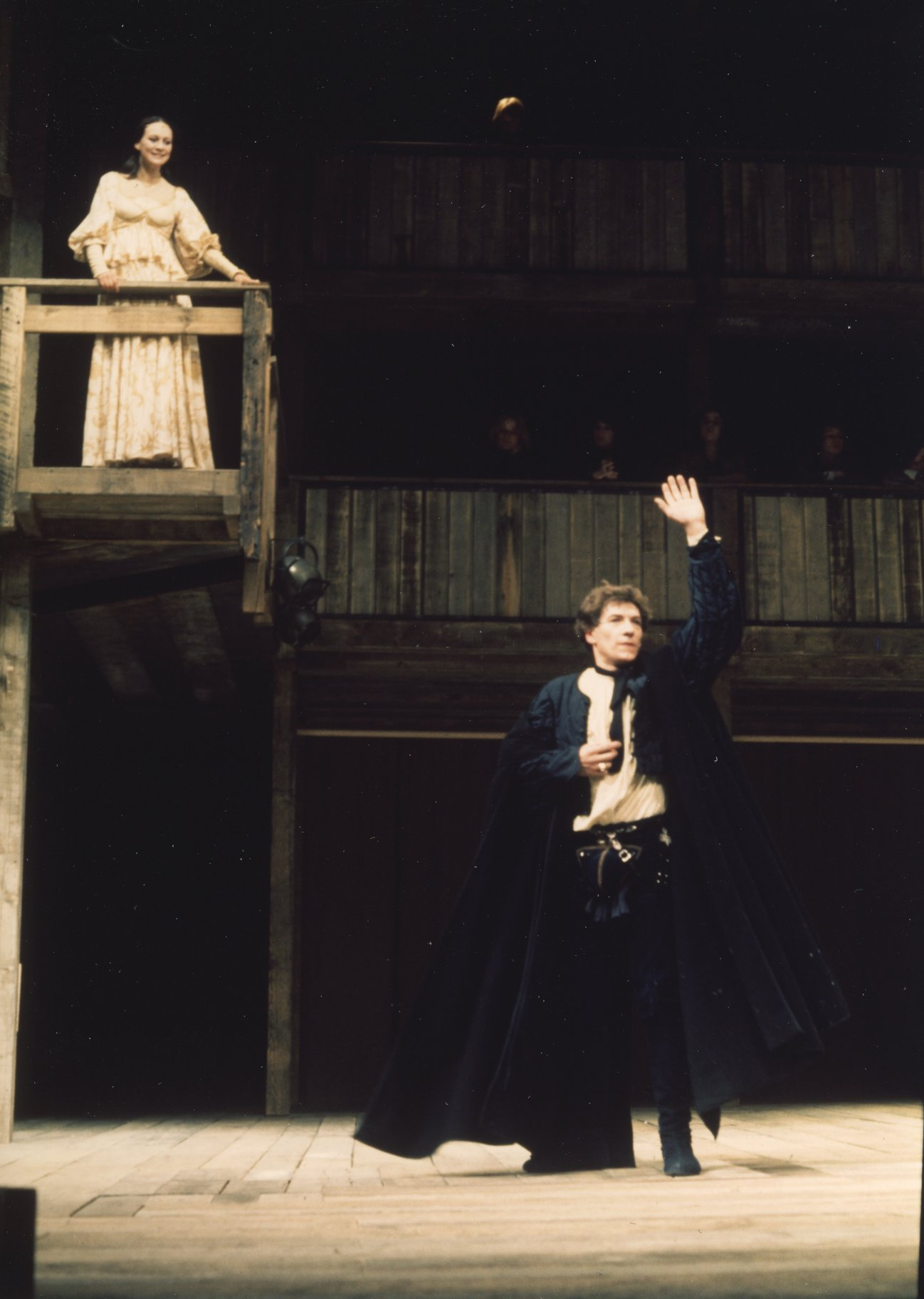 Romeo stands under Juliet's balcony.