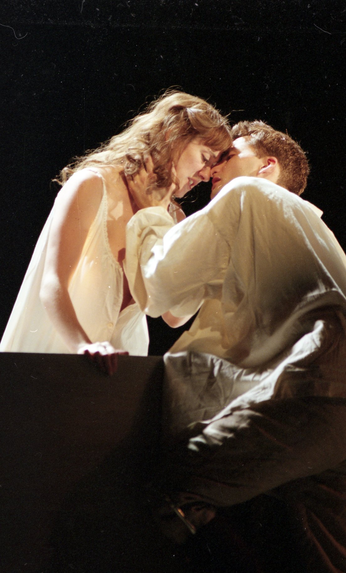 Romeo and Juliet kiss before parting.