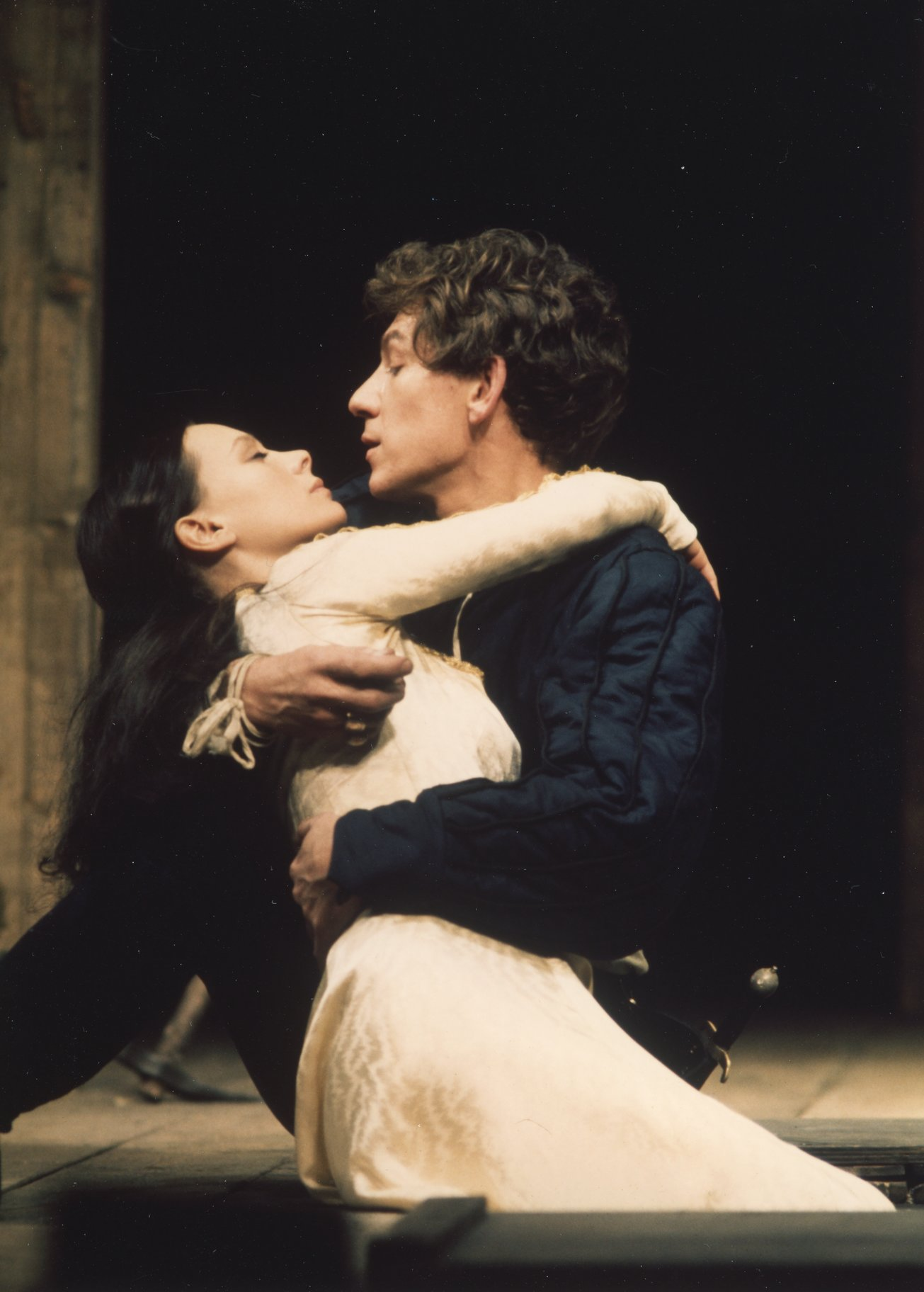 Romeo and Juliet embrace on the floor.