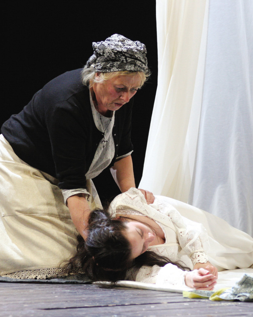 The Nurse leans over Juliet's body.
