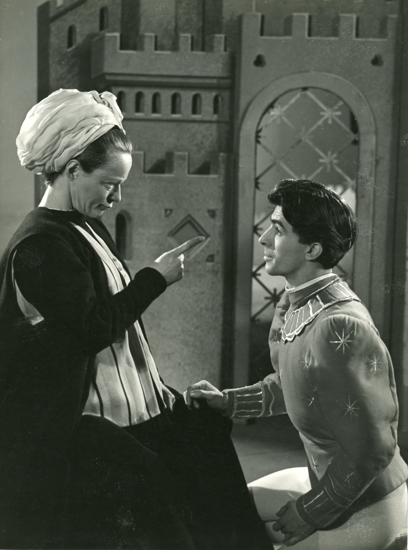The nurse points an accusing finger at Romeo.