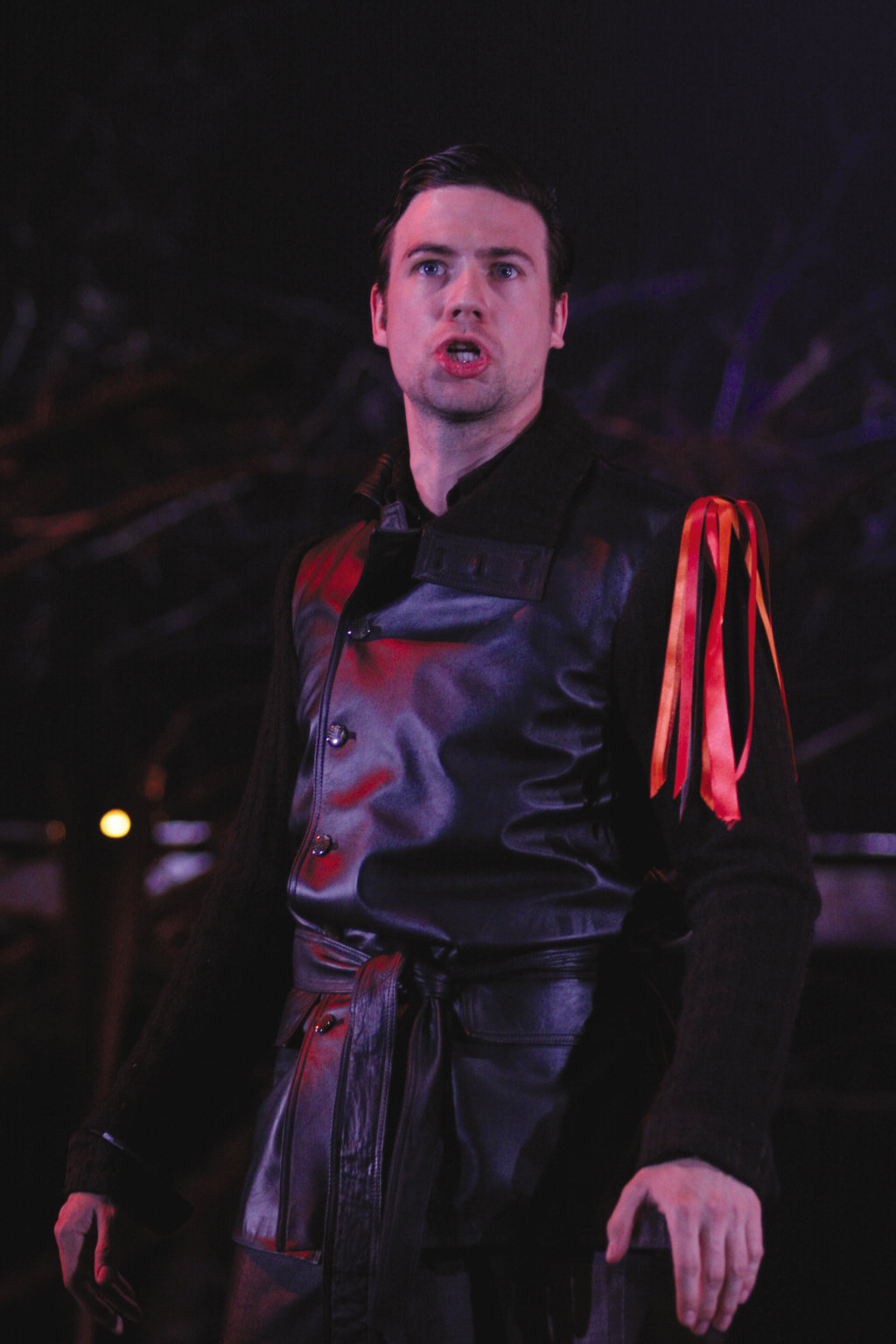 Tybalt in black with red ribbons on his arm.