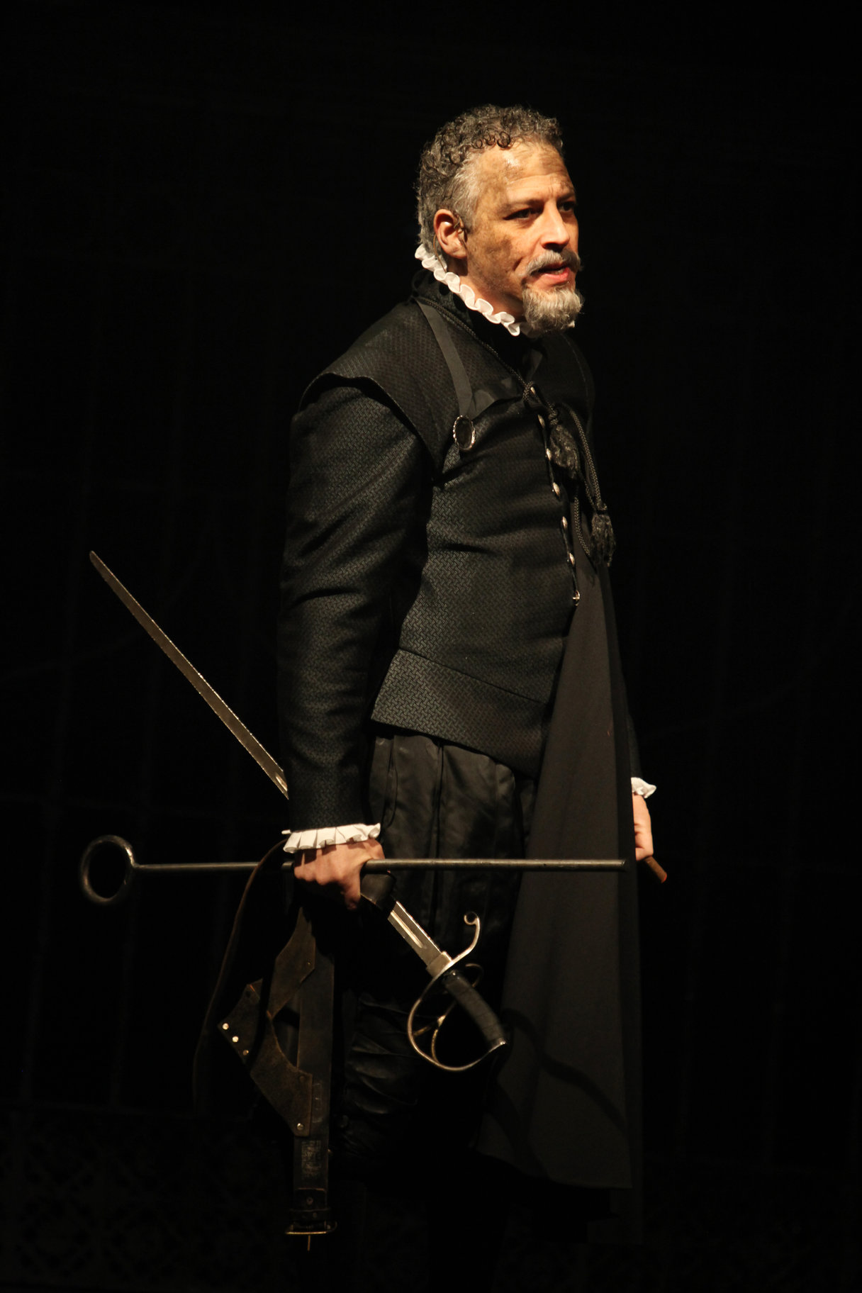 Lord Montague in black with swords.