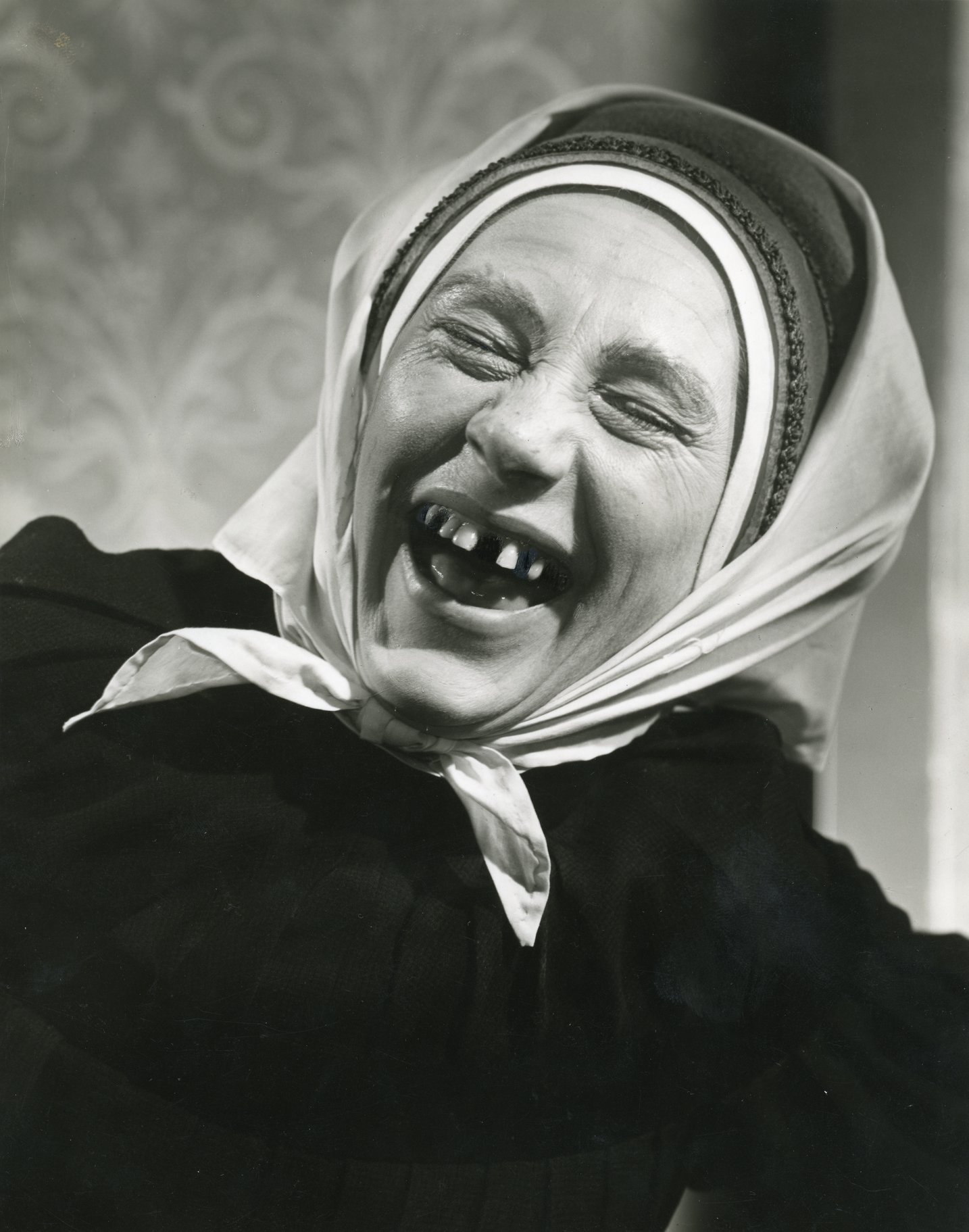 Angela Baddeley as the Nurse, laughing.