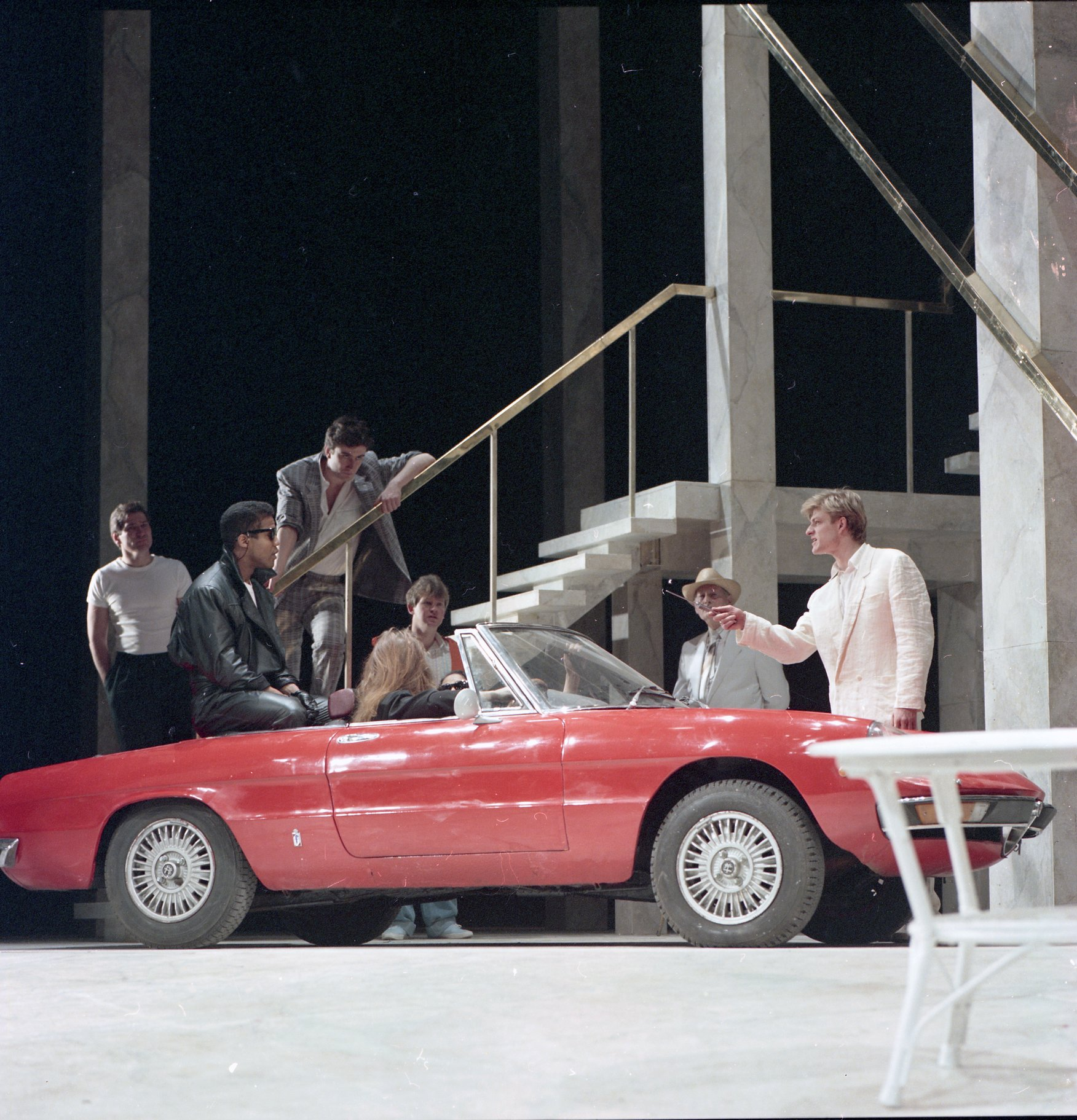 A red car is on stage.