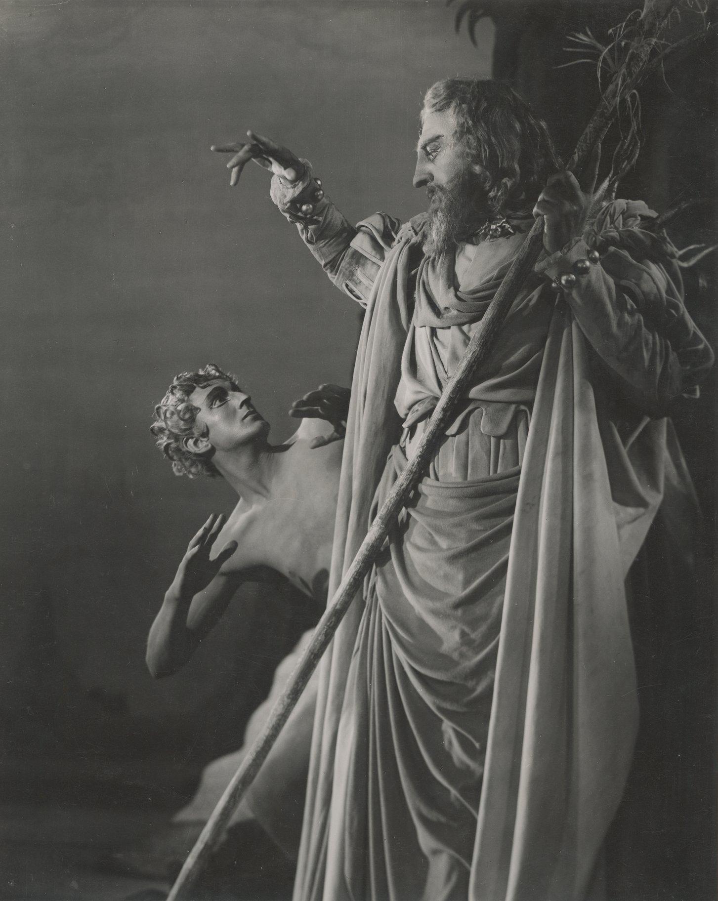 Prospero stands over Ariel.
