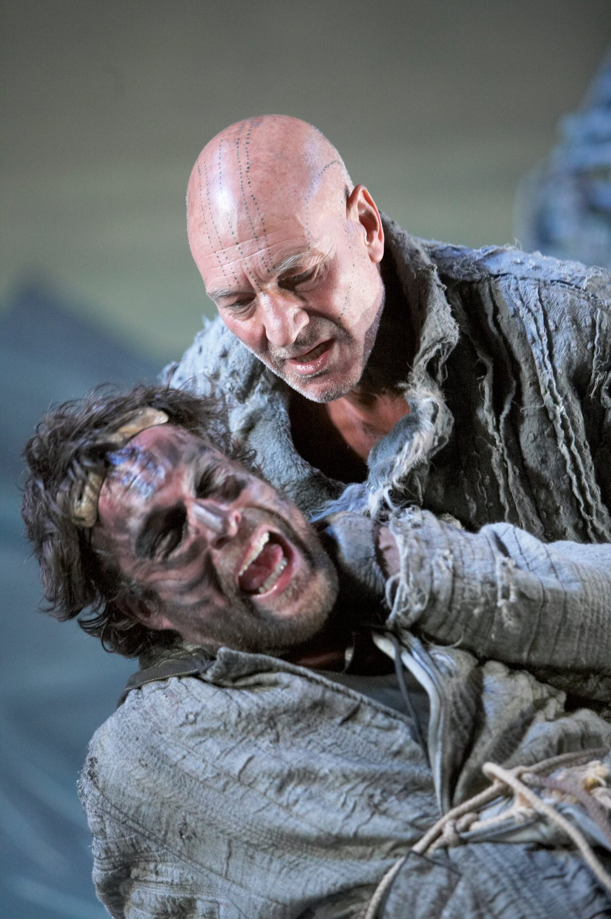 Caliban and Prospero.