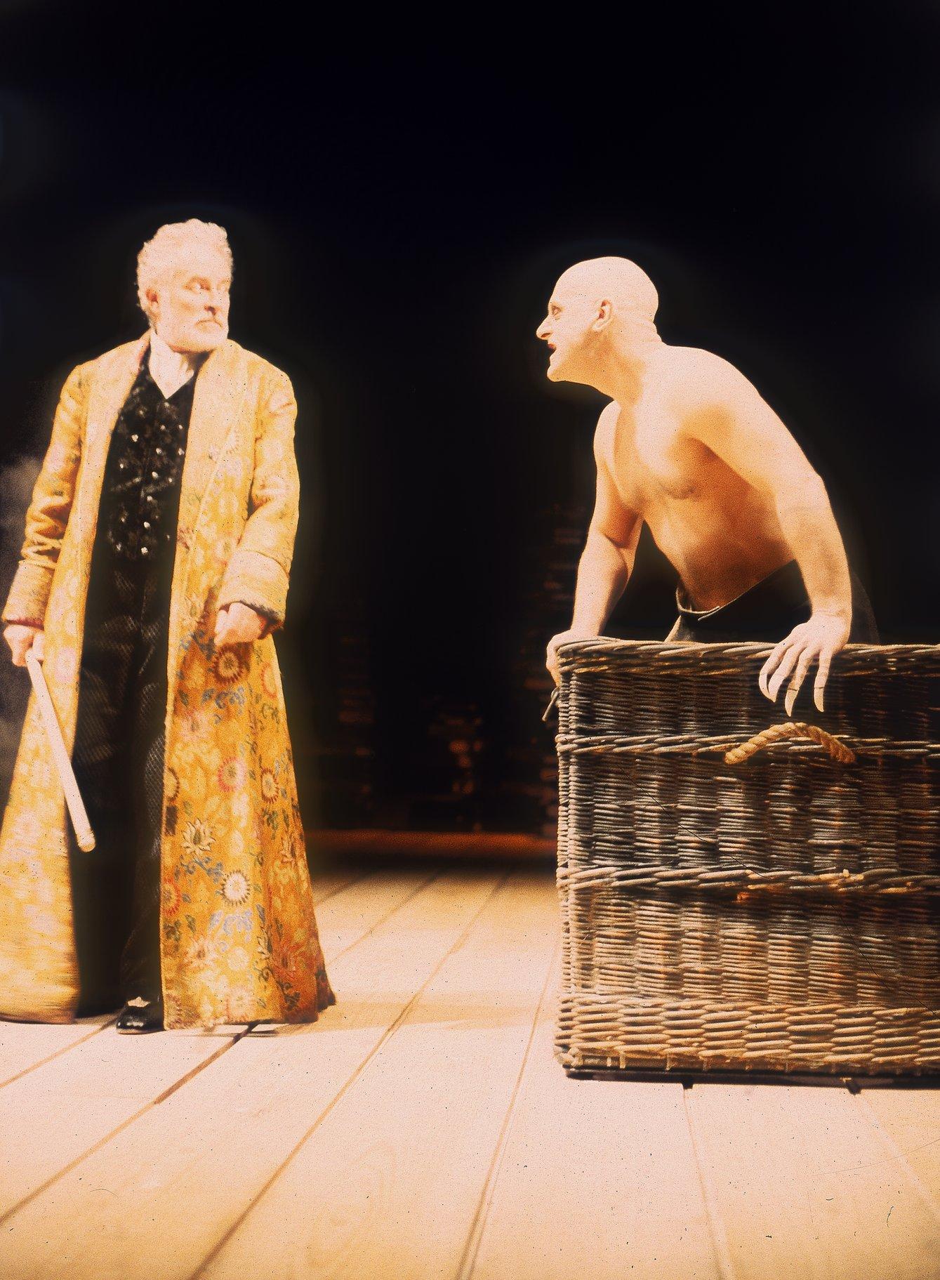 Caliban sneers at Prospero.