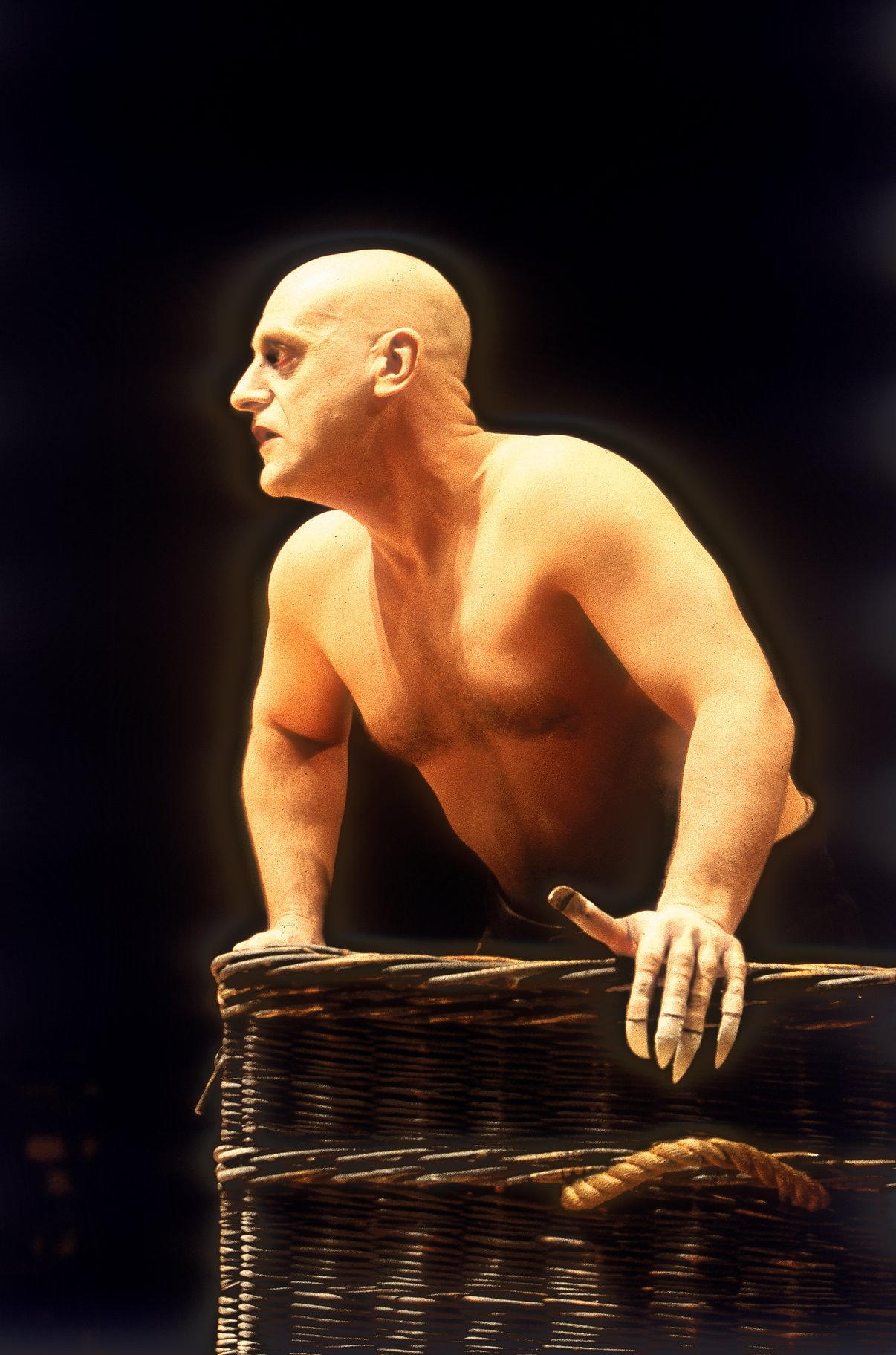 David Troughton as Caliban, rising out of a wicker basket.