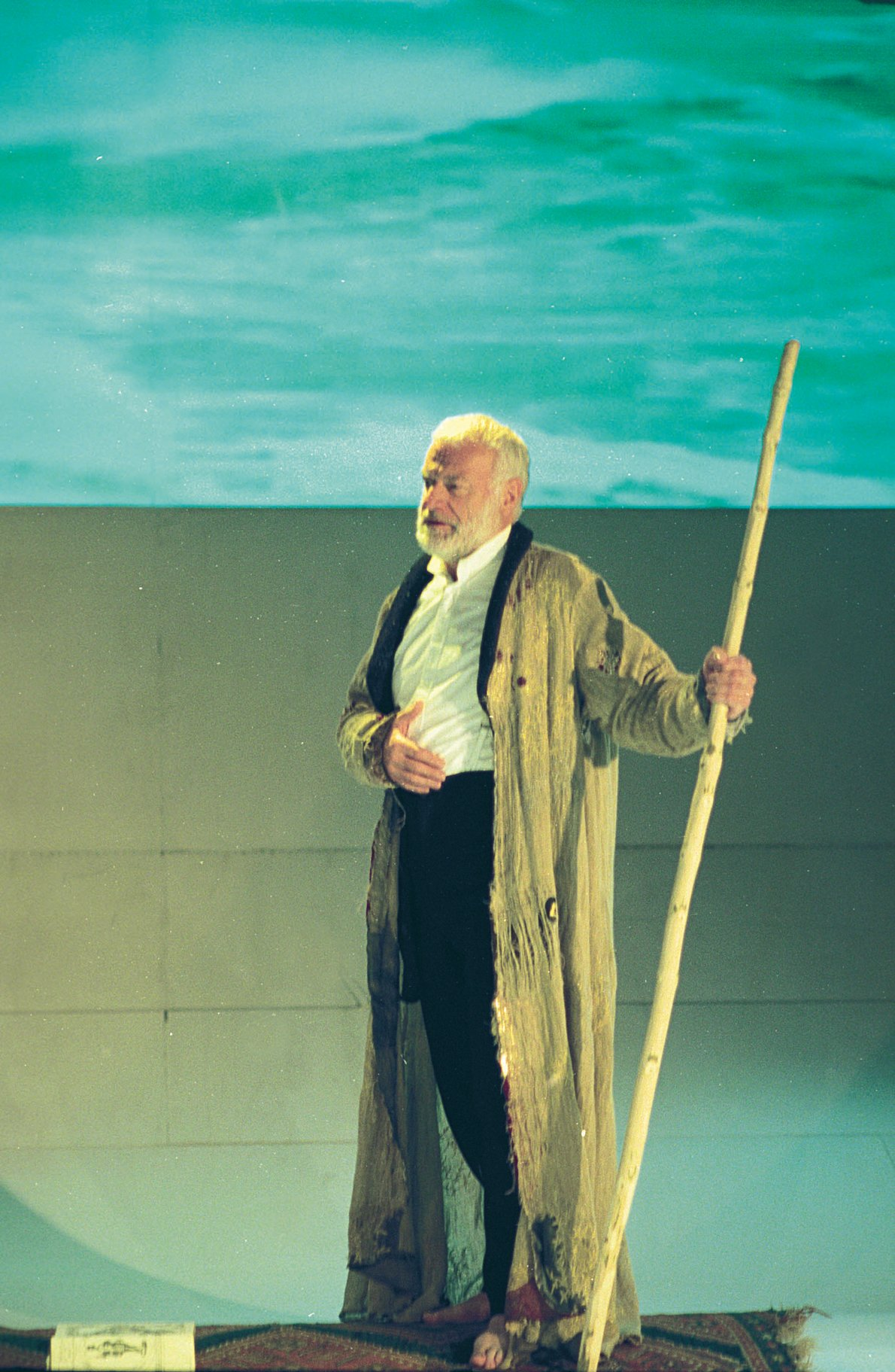 Prospero with his staff.