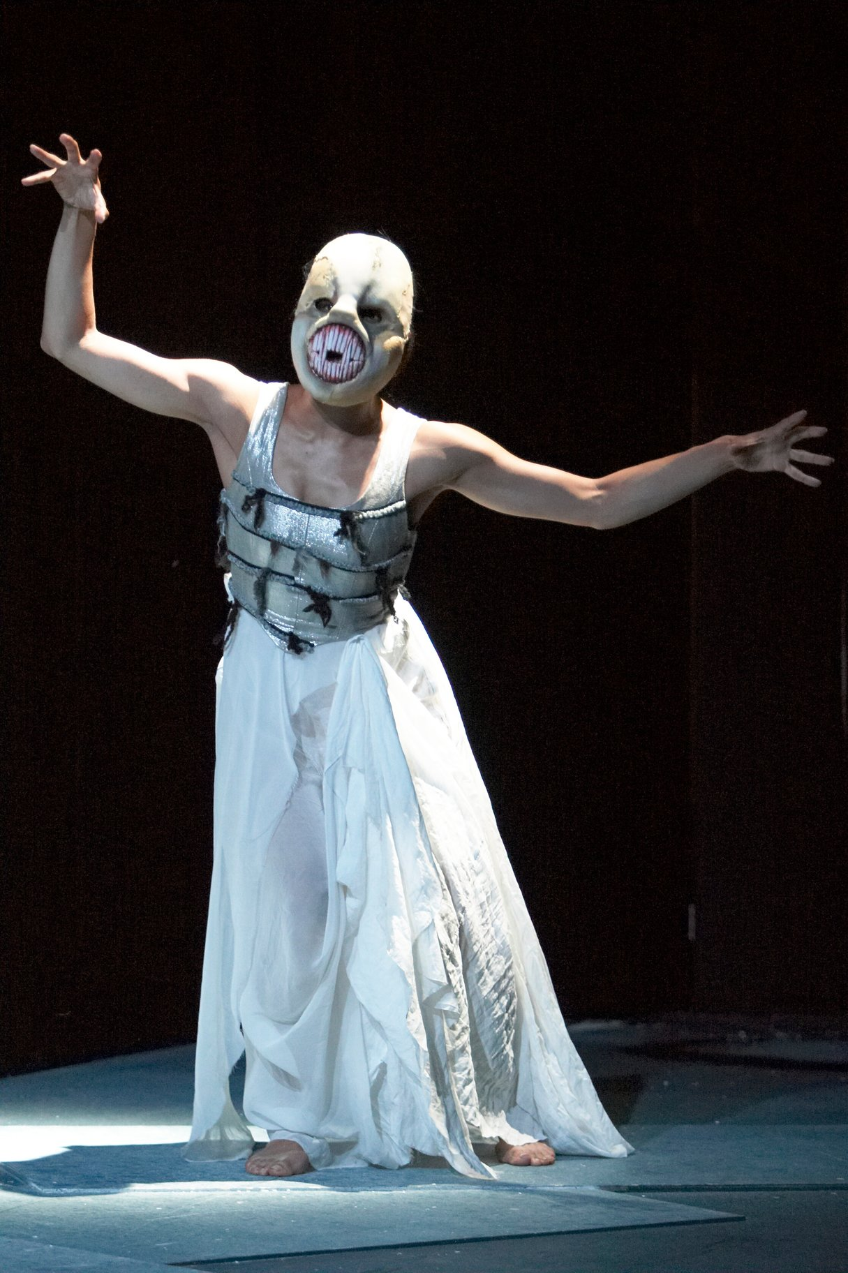 A spirit of the island, wearing a fish-like mask.