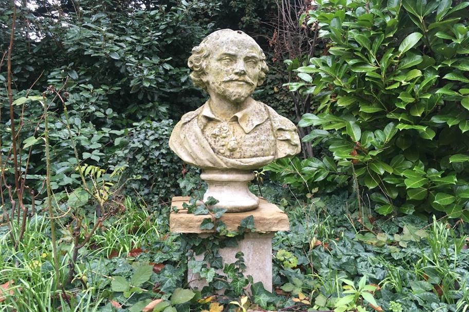 a stone bust of Shakespeare in the garden at the Shakespeare Institute