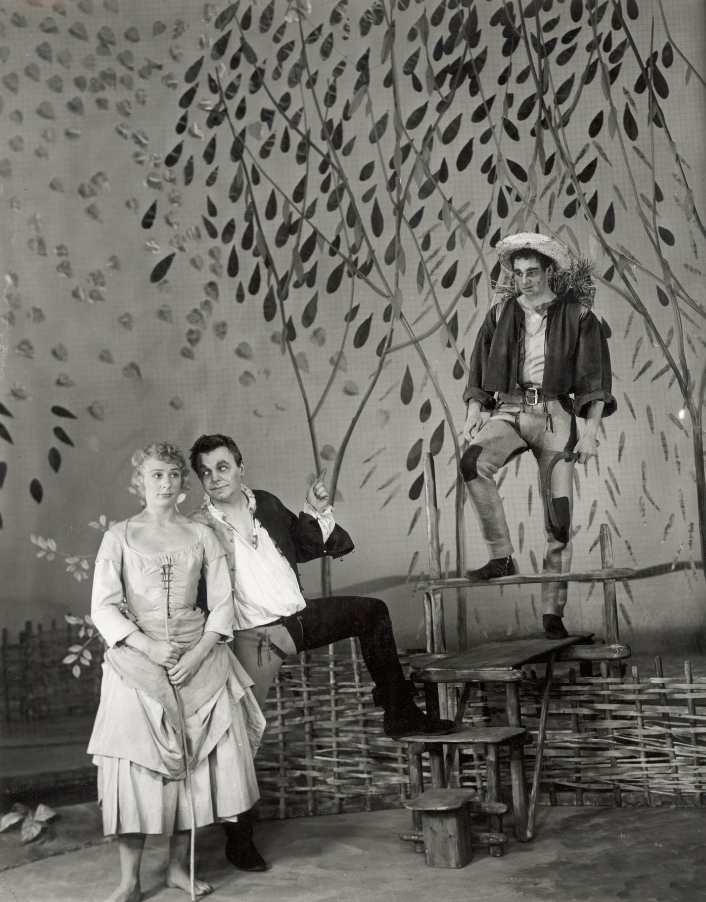 A man and woman under a tree.