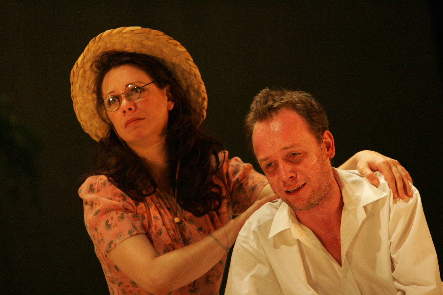 A woman comforts a sad man.