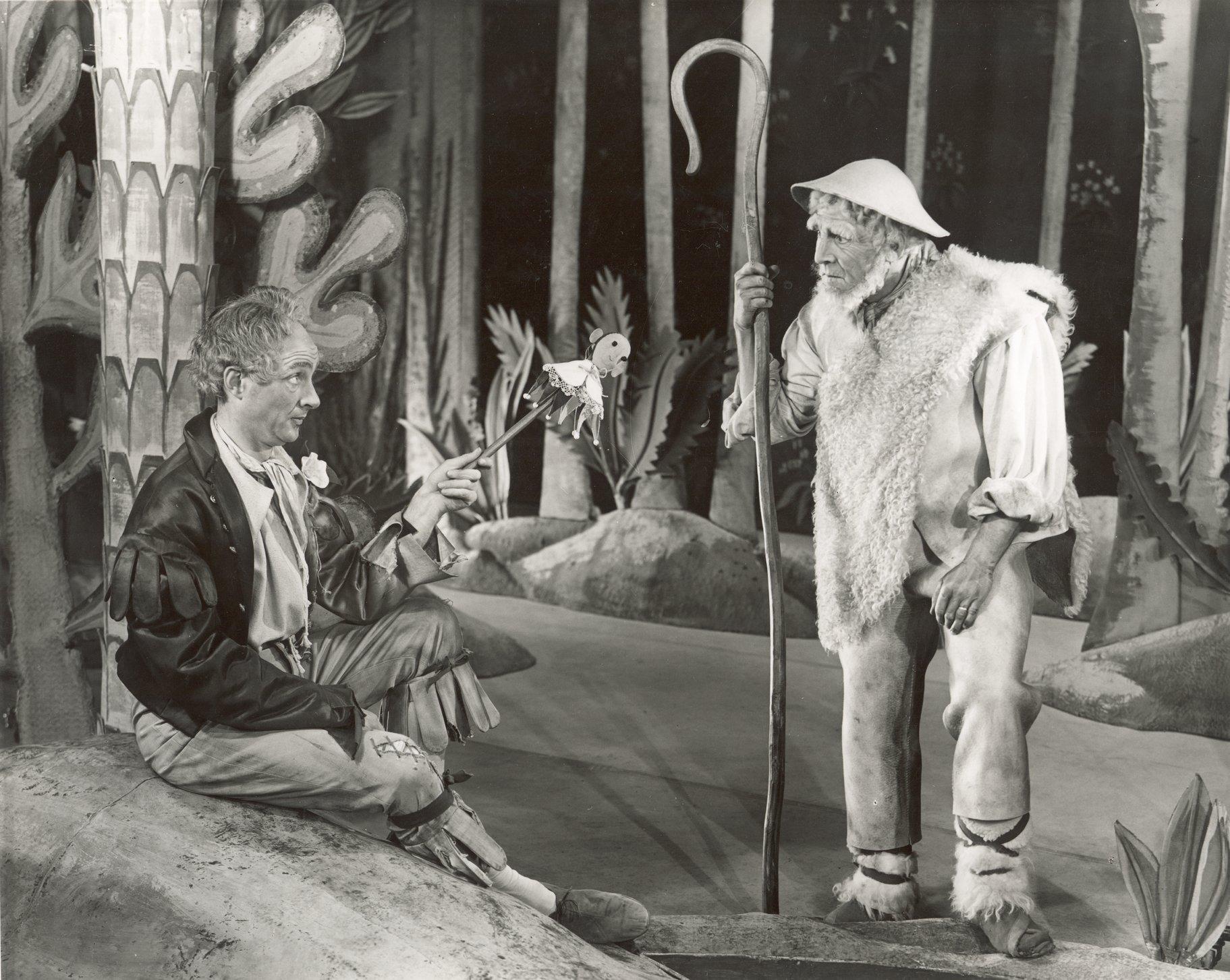 A man talks to an elderly shepherd.