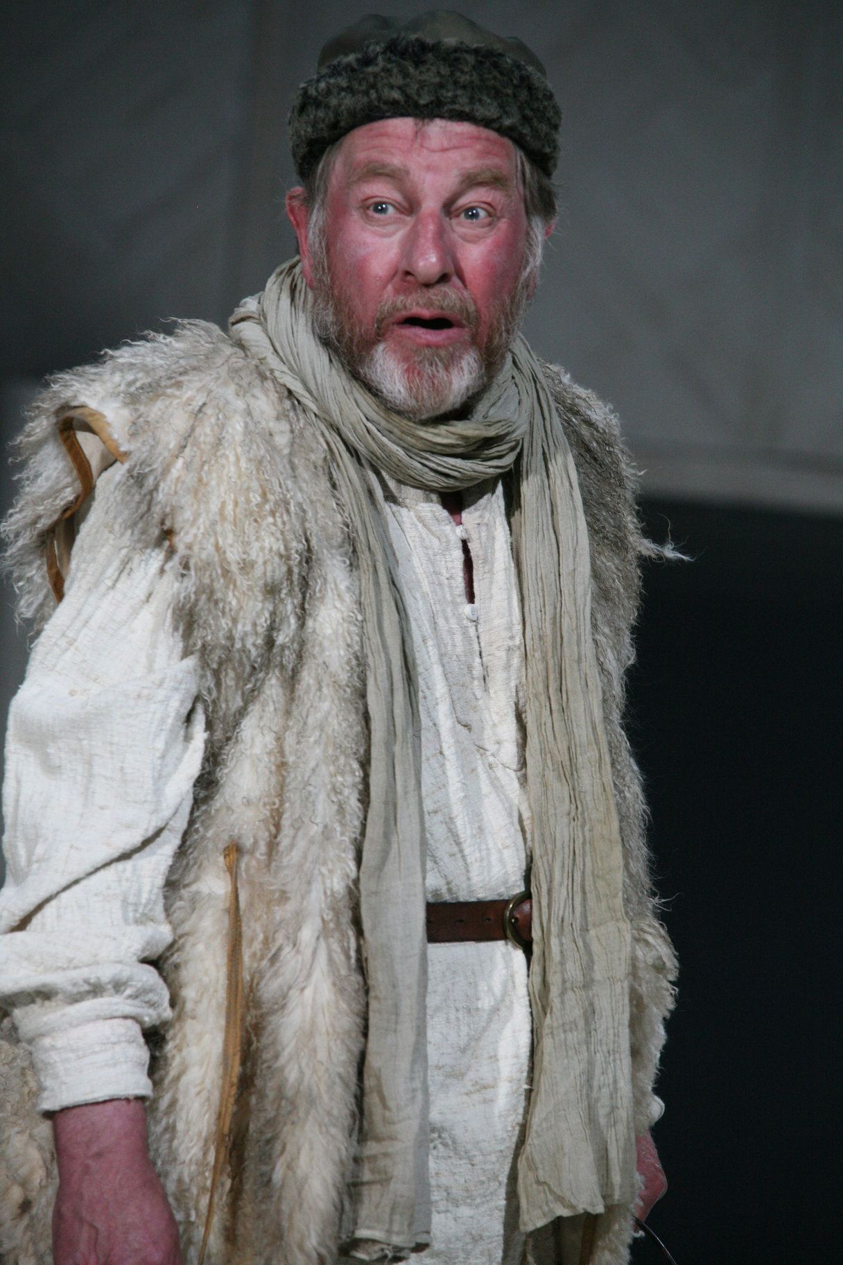 A man in furs, a scarf and hat.