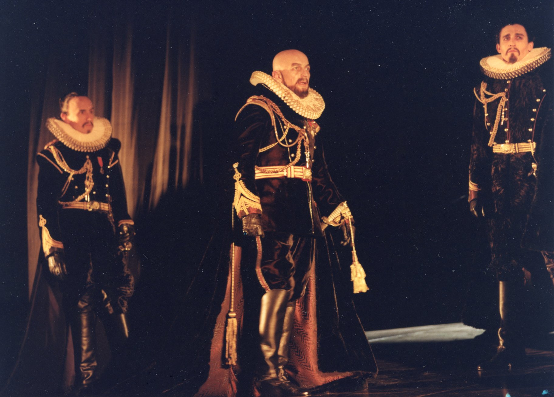Three lords in elaborate gowns.