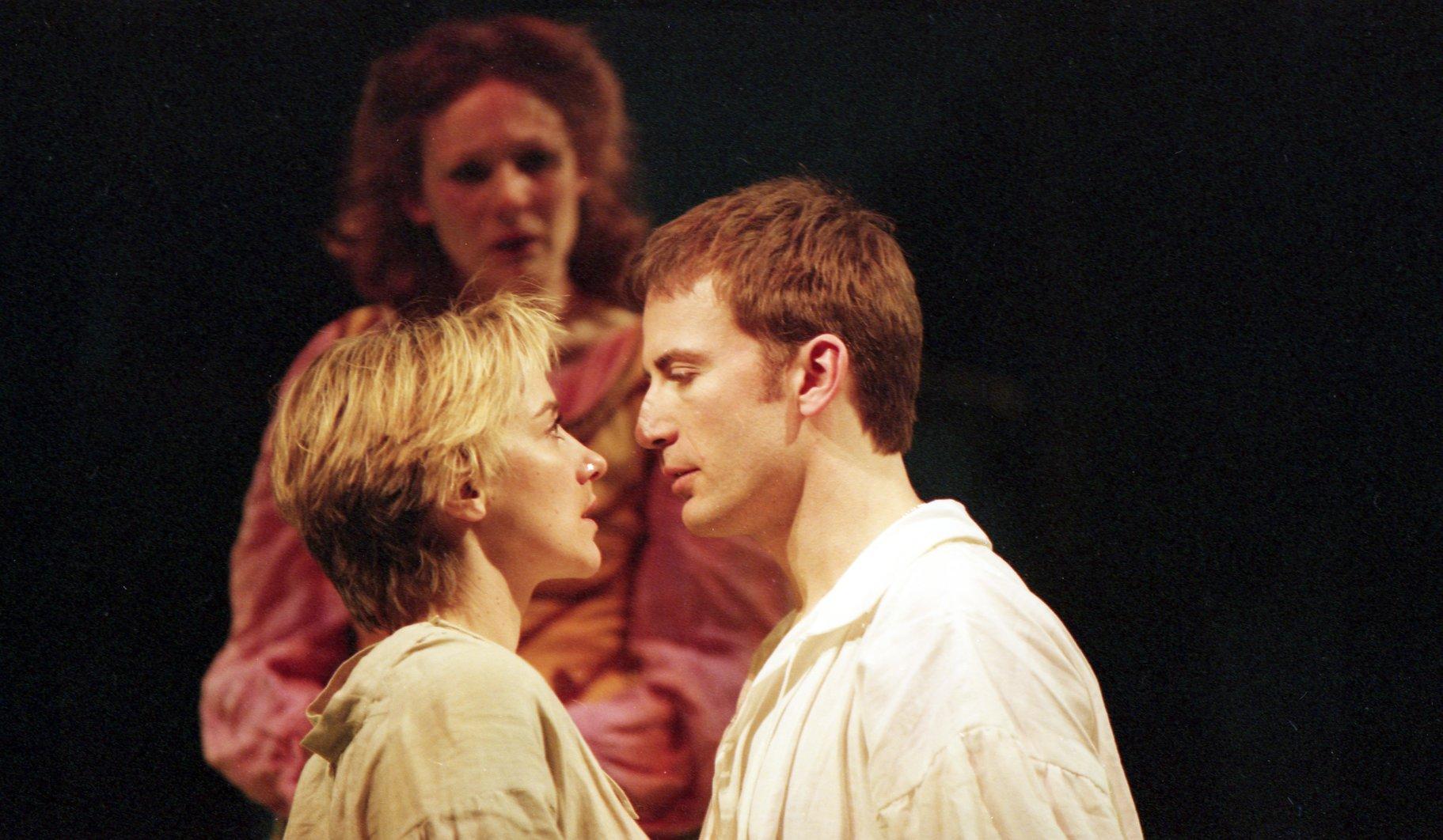 Rosalind, dressed as Ganymede, with Orlando.