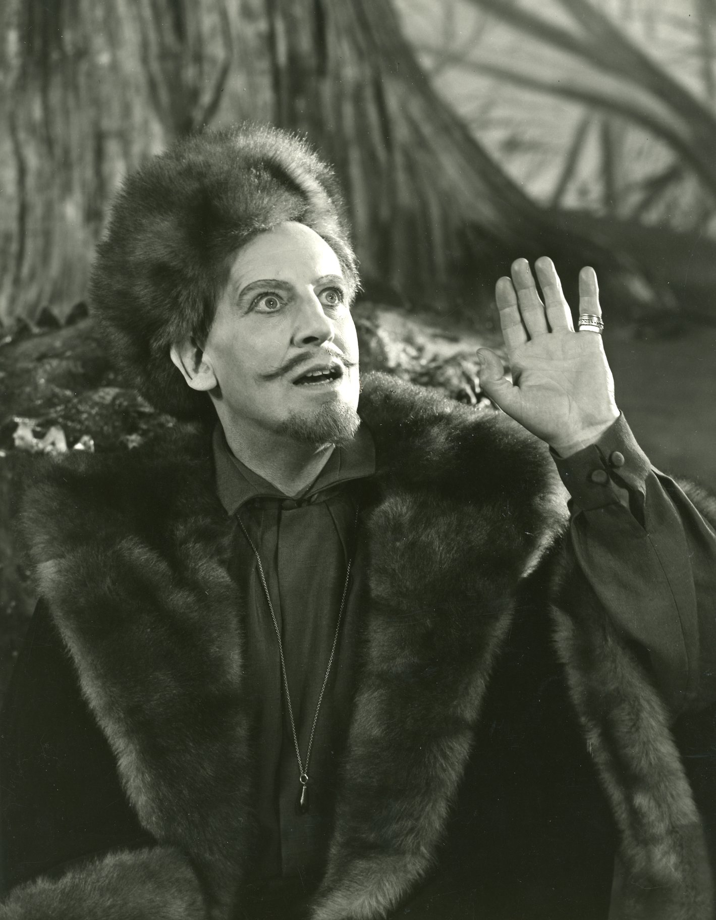 A man in furs with a long moustache.