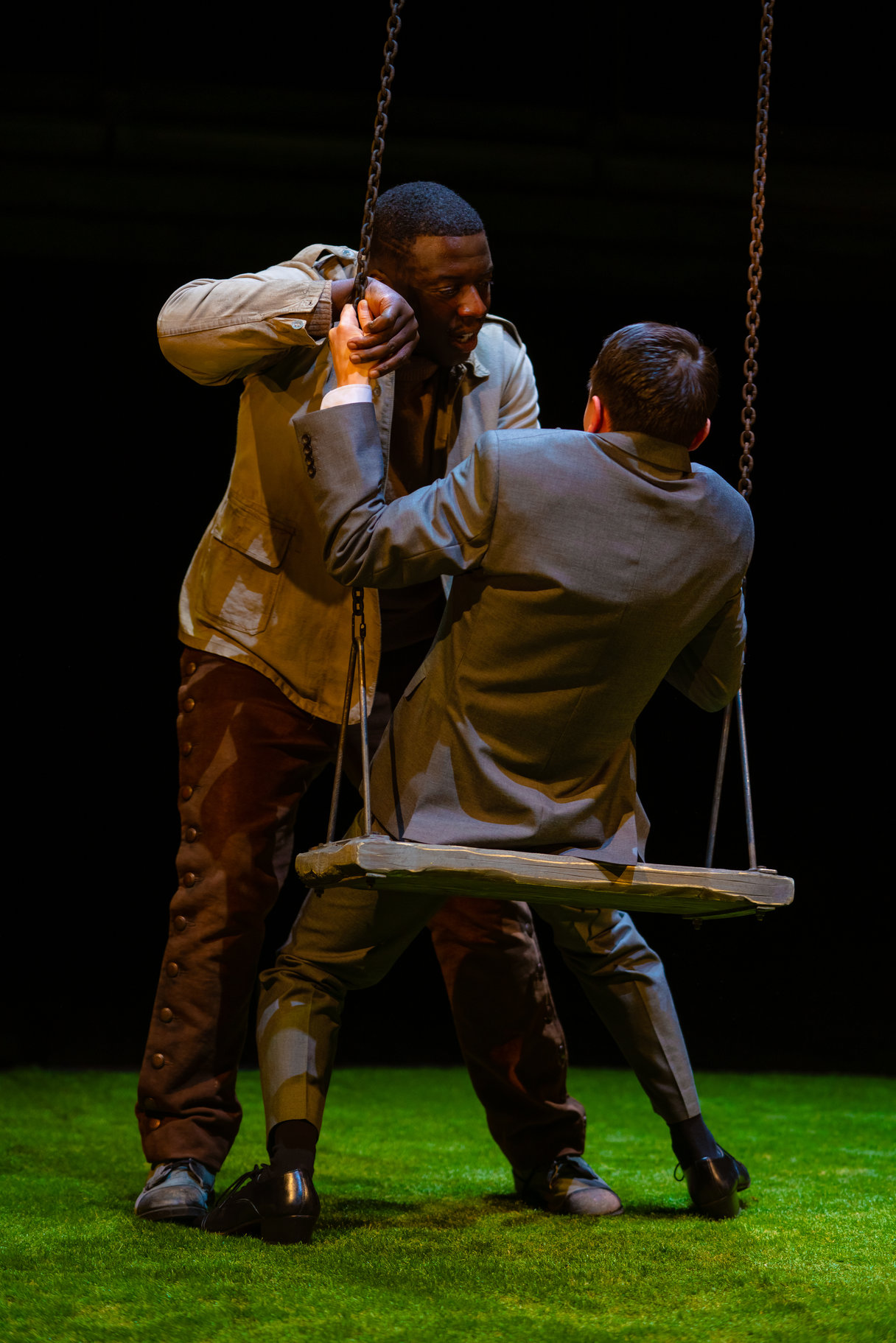 Orlando confronts Oliver on a swing.