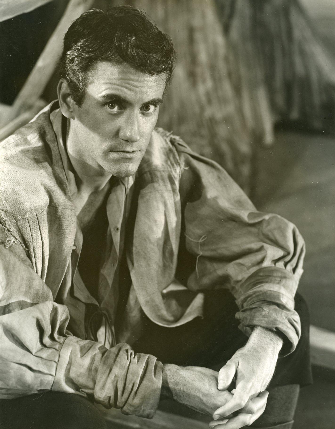 A man in a puffy shirt.