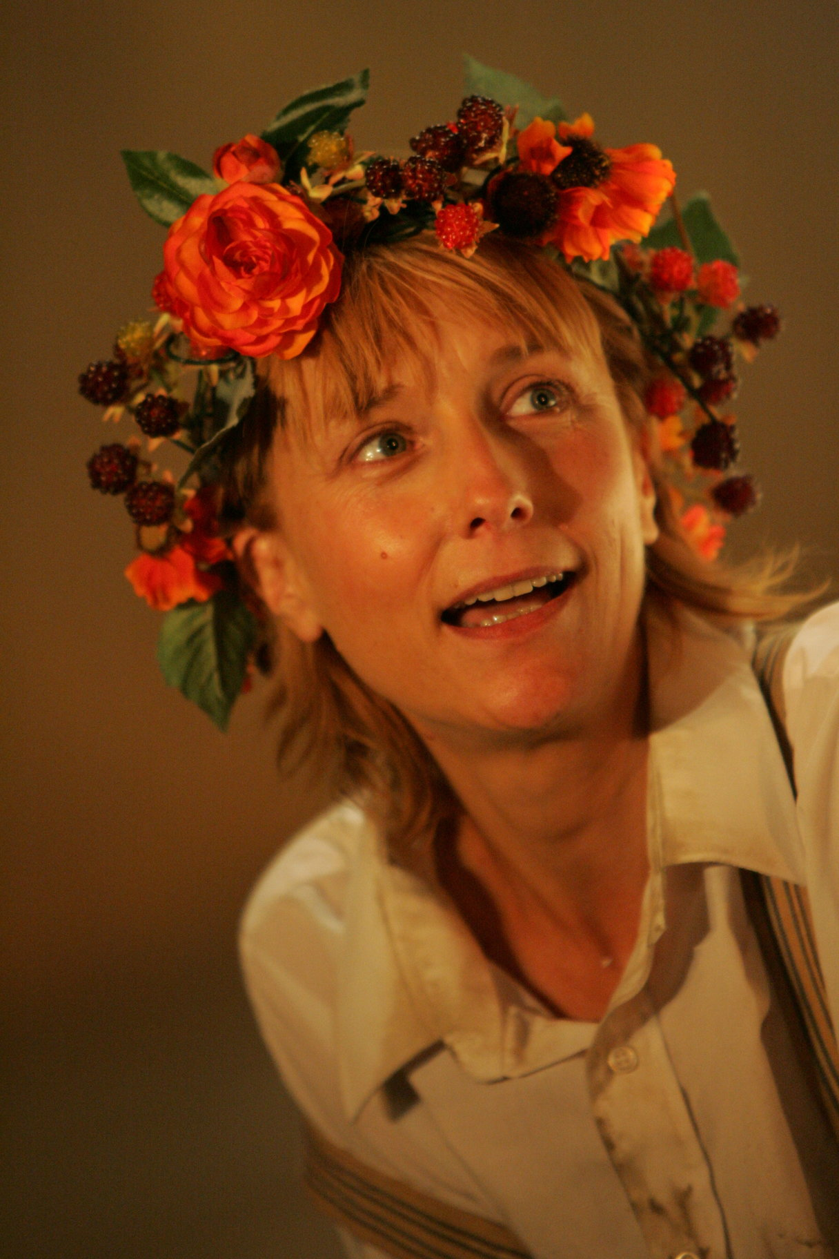 A woman in a floral garland.
