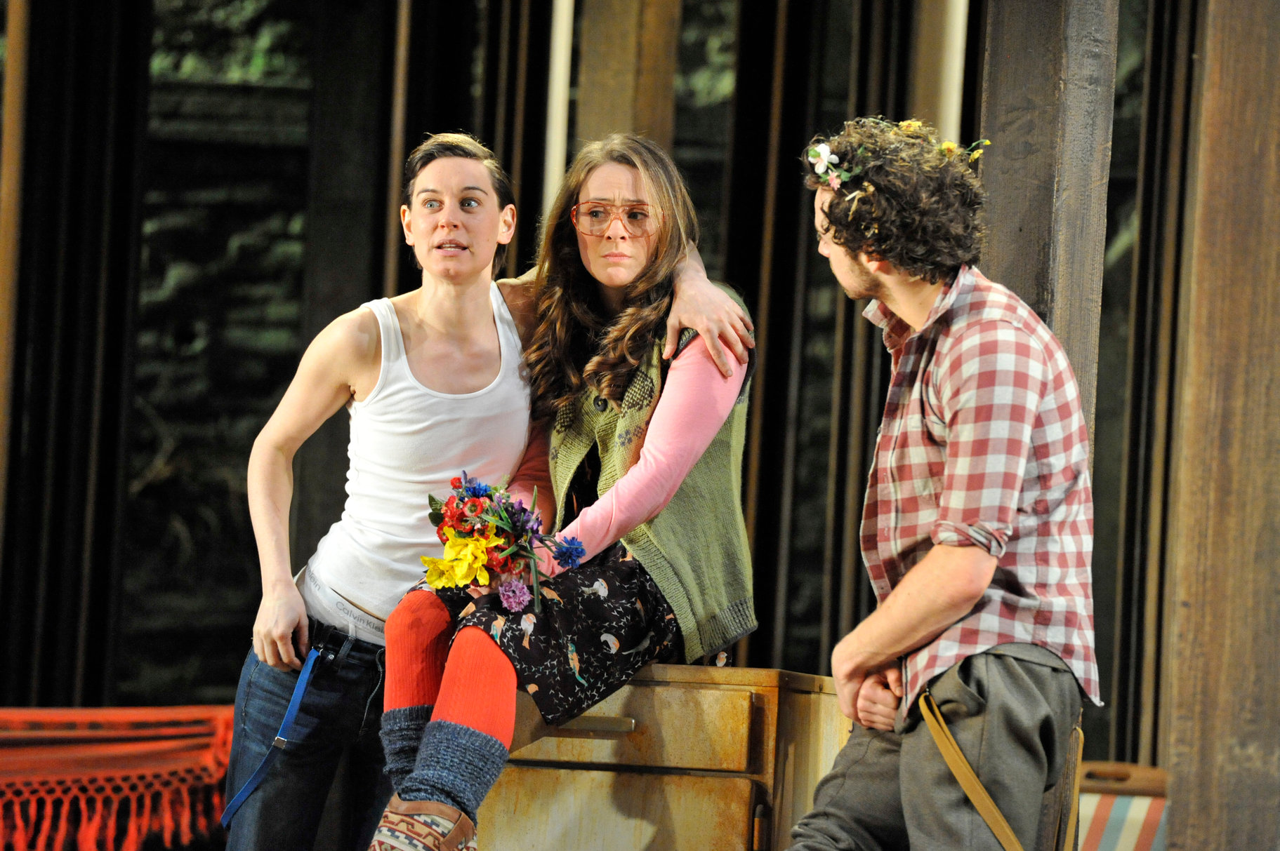 Celia and Rosalind in their disguises, talking to Orlando.