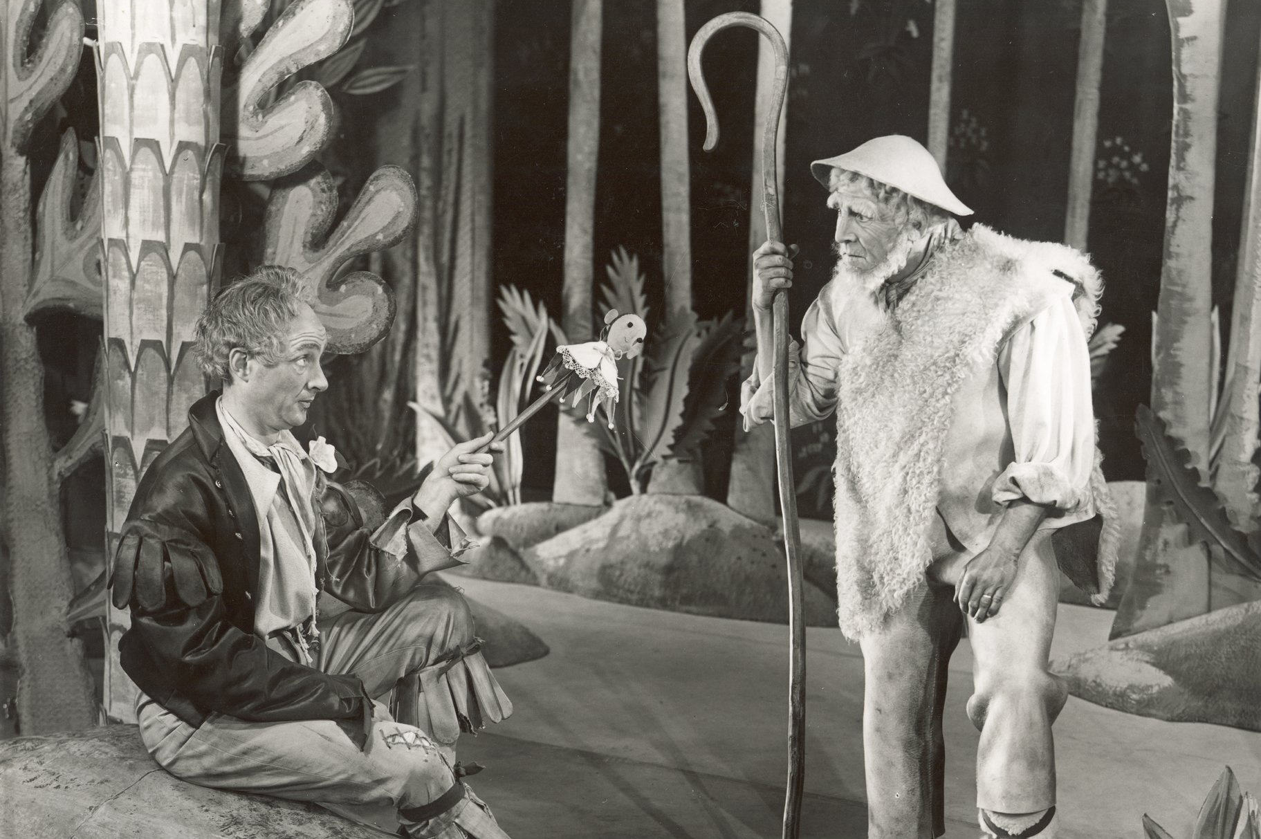 Touchstone and Corin in the forest together.