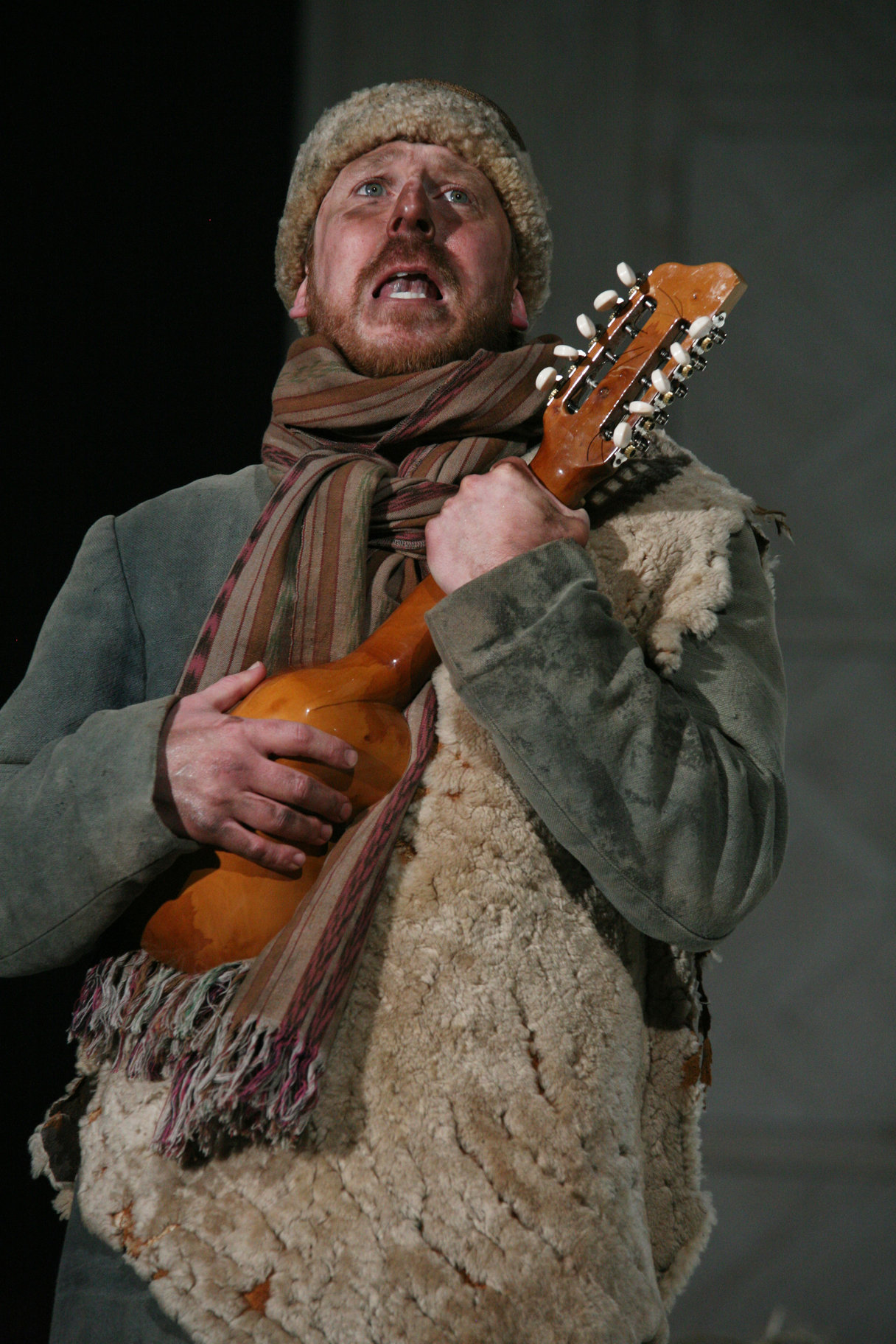 Silvius with a dirty face and a mandolin.