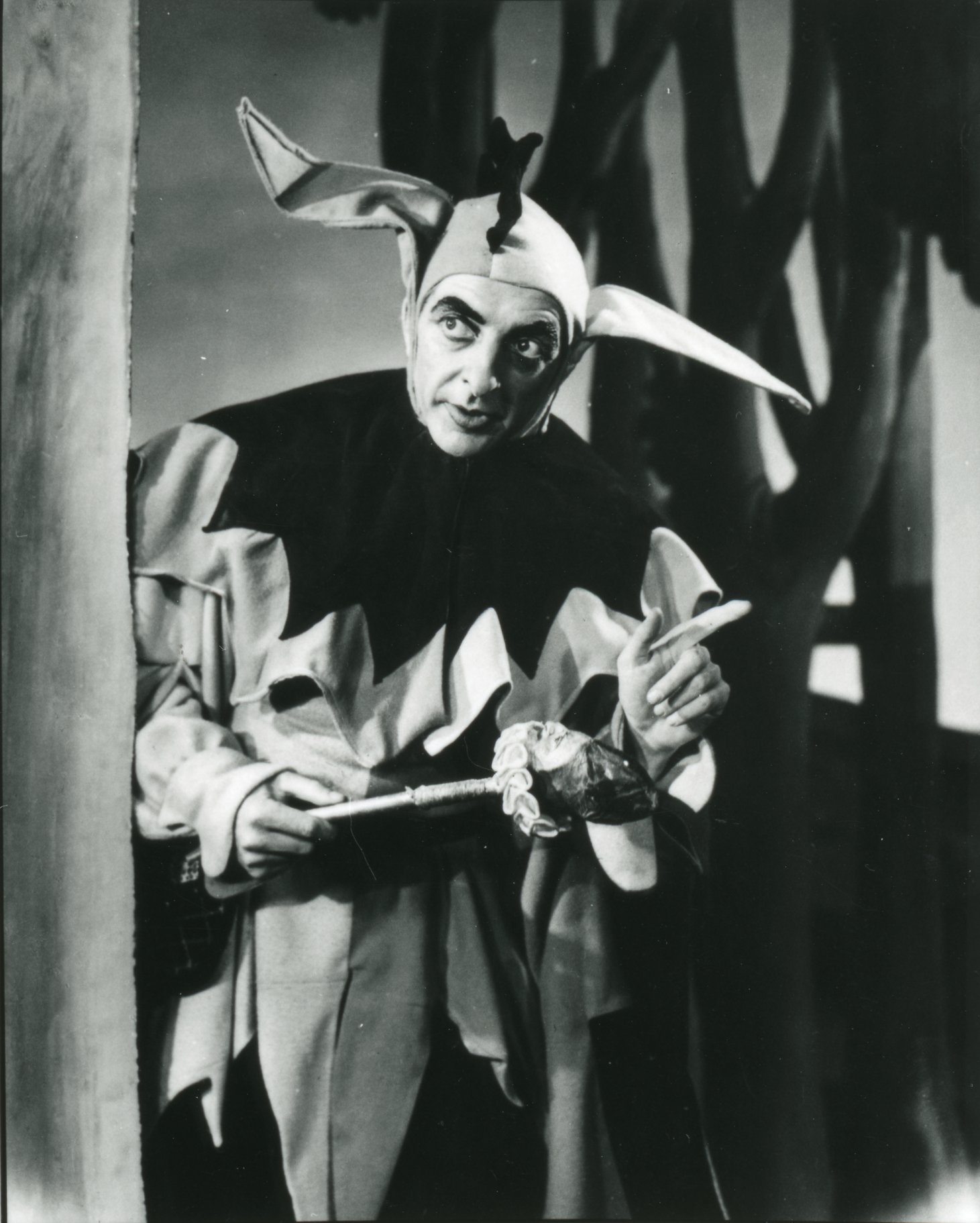 A man in a jester's outfit.