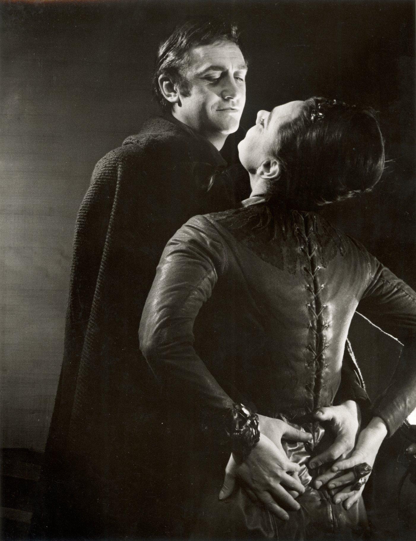 Edmund flirts with Goneril, his hands round her waist.