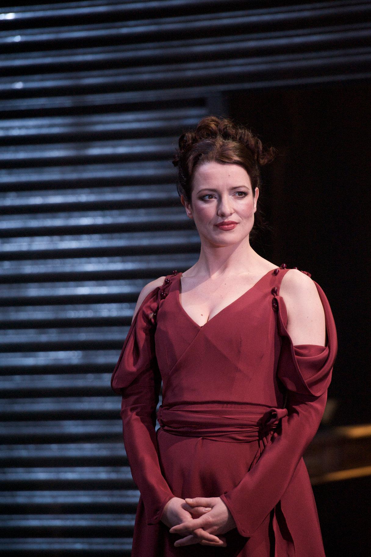 Regan in a dark red gown.