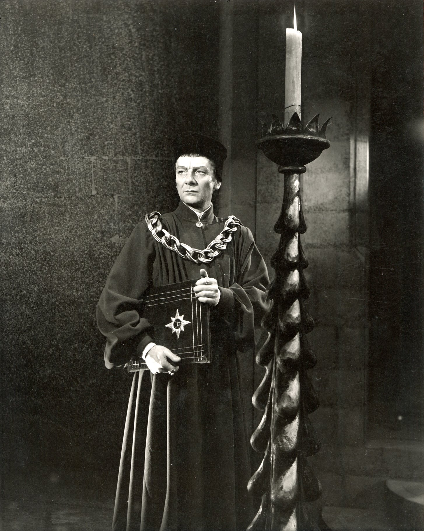 A man in robes and a thick gold chain.