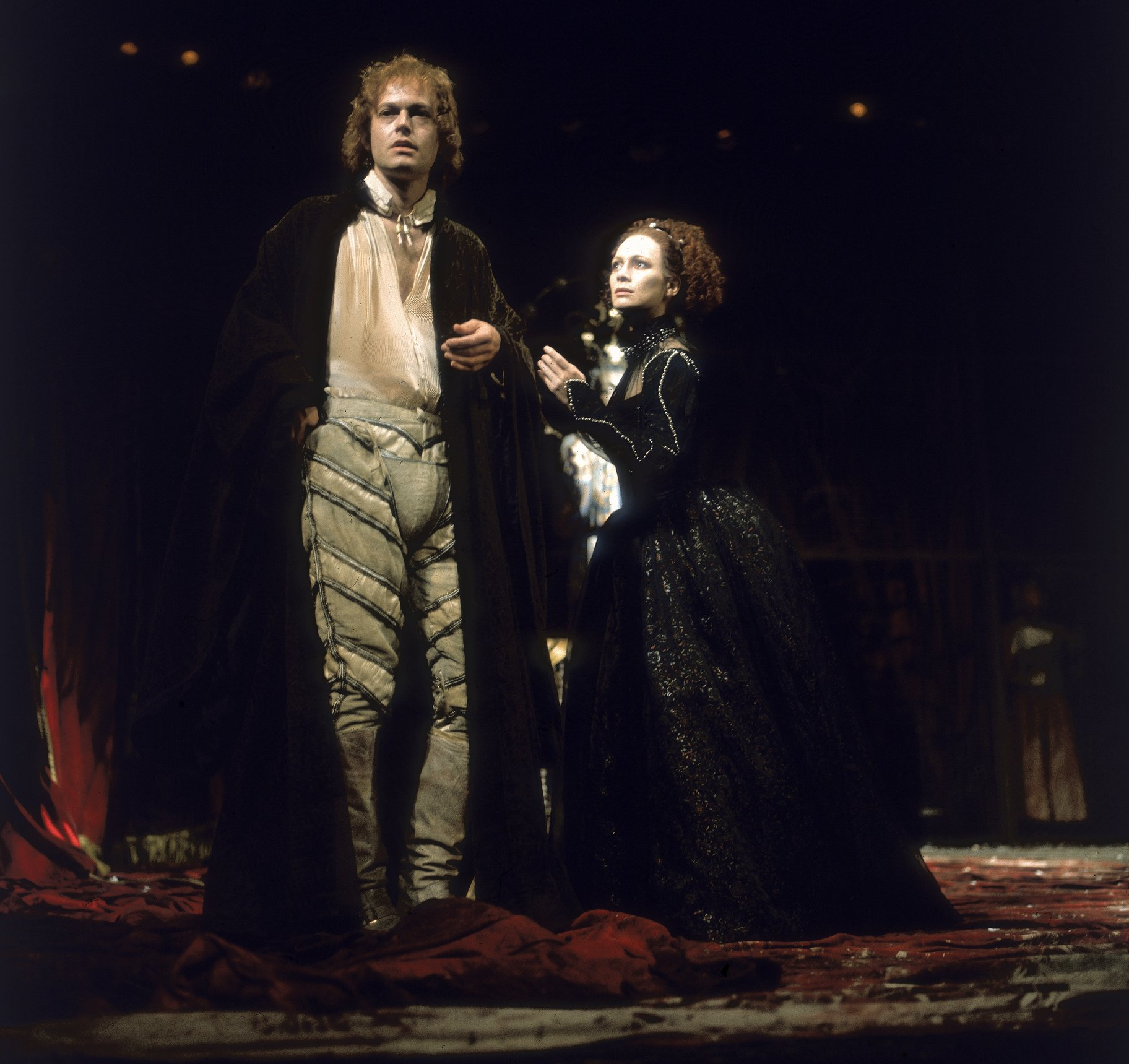 A man standing next to a woman in an elaborate gown.