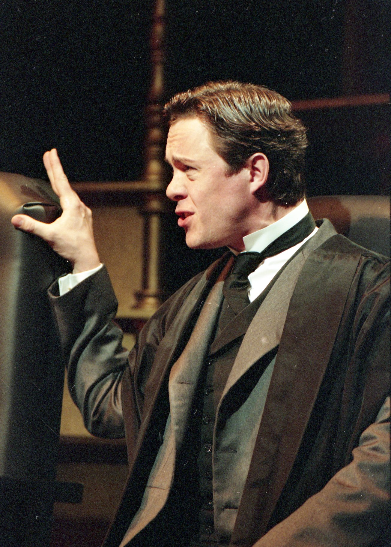 A man in black suit and robes.